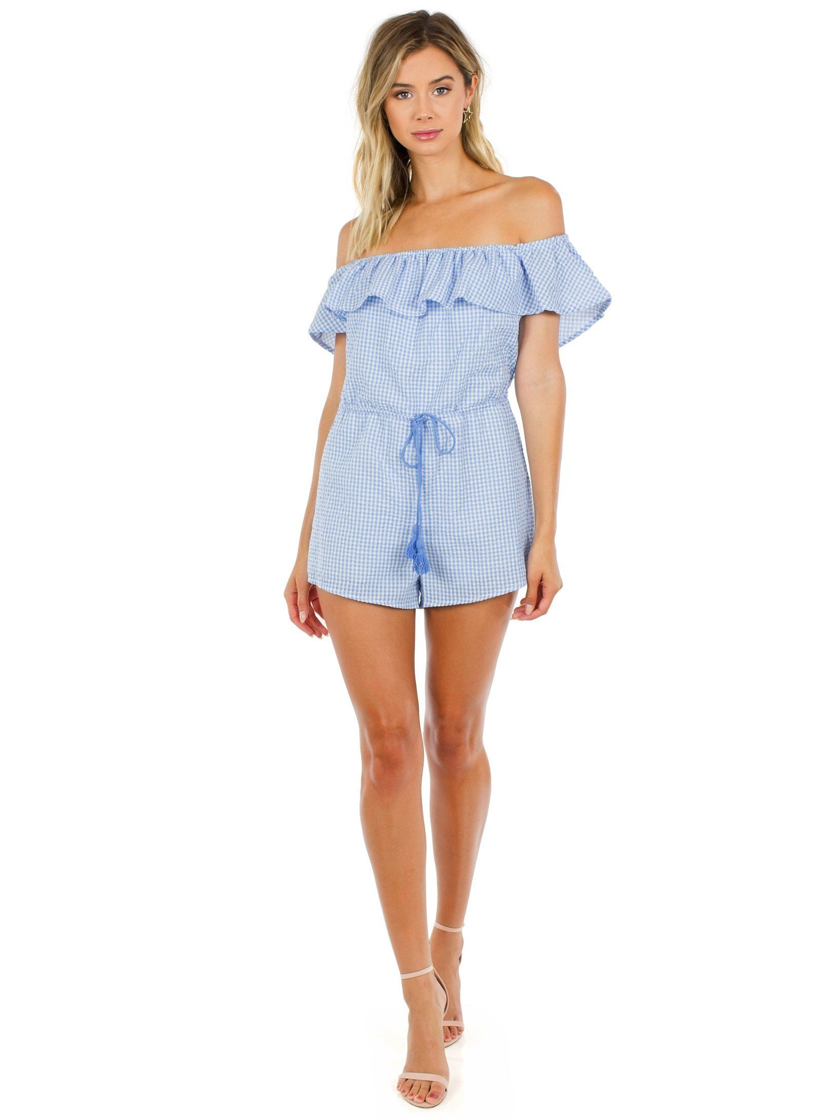 Girl outfit in a romper rental from FashionPass called Going Gingham Romper