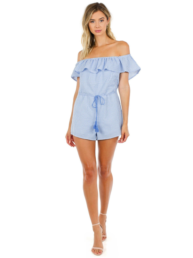 Women wearing a romper rental from FashionPass called Going Gingham Romper