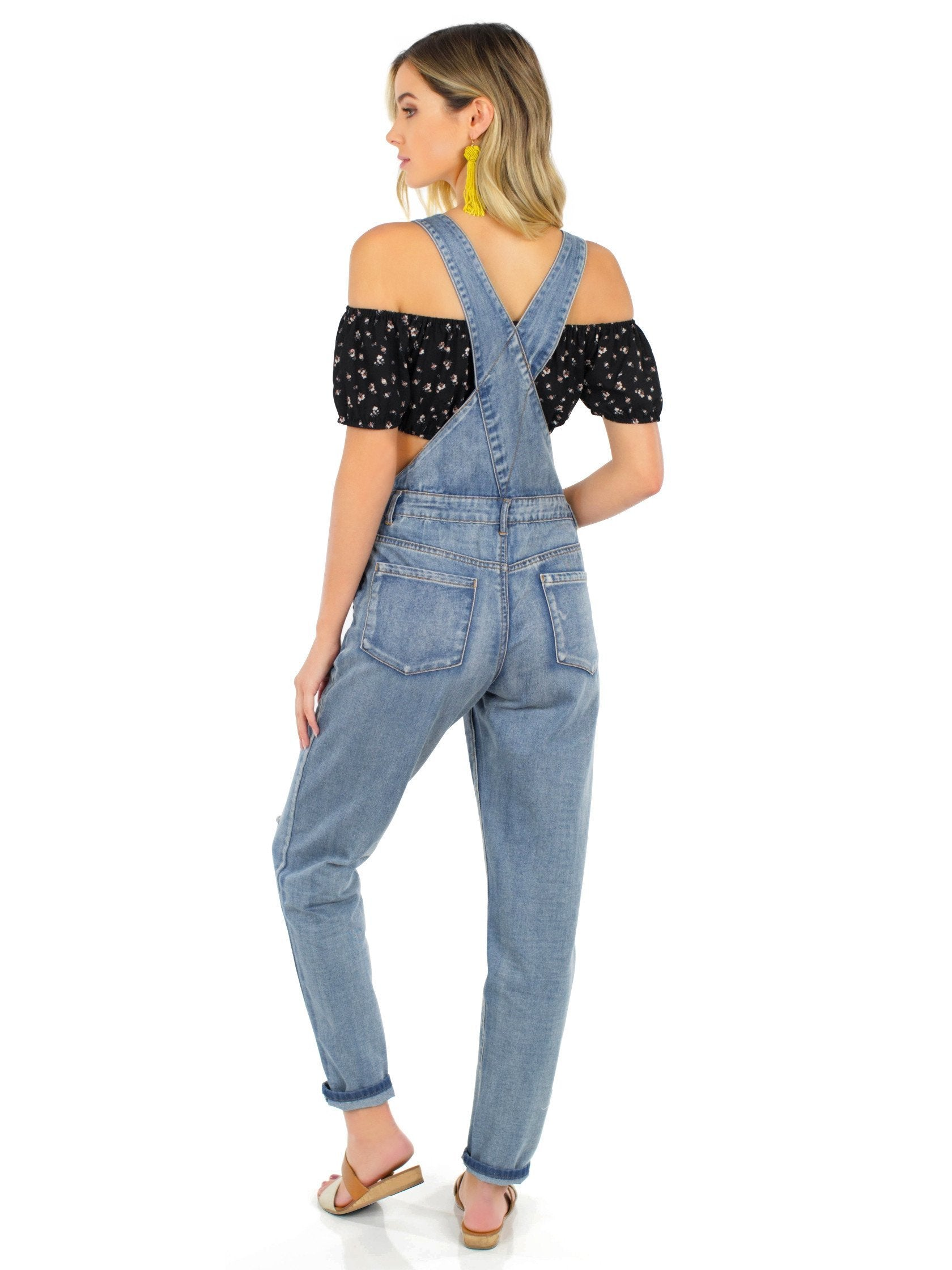 Women wearing a jumpsuit rental from FashionPass called Here For A Good Time Overalls