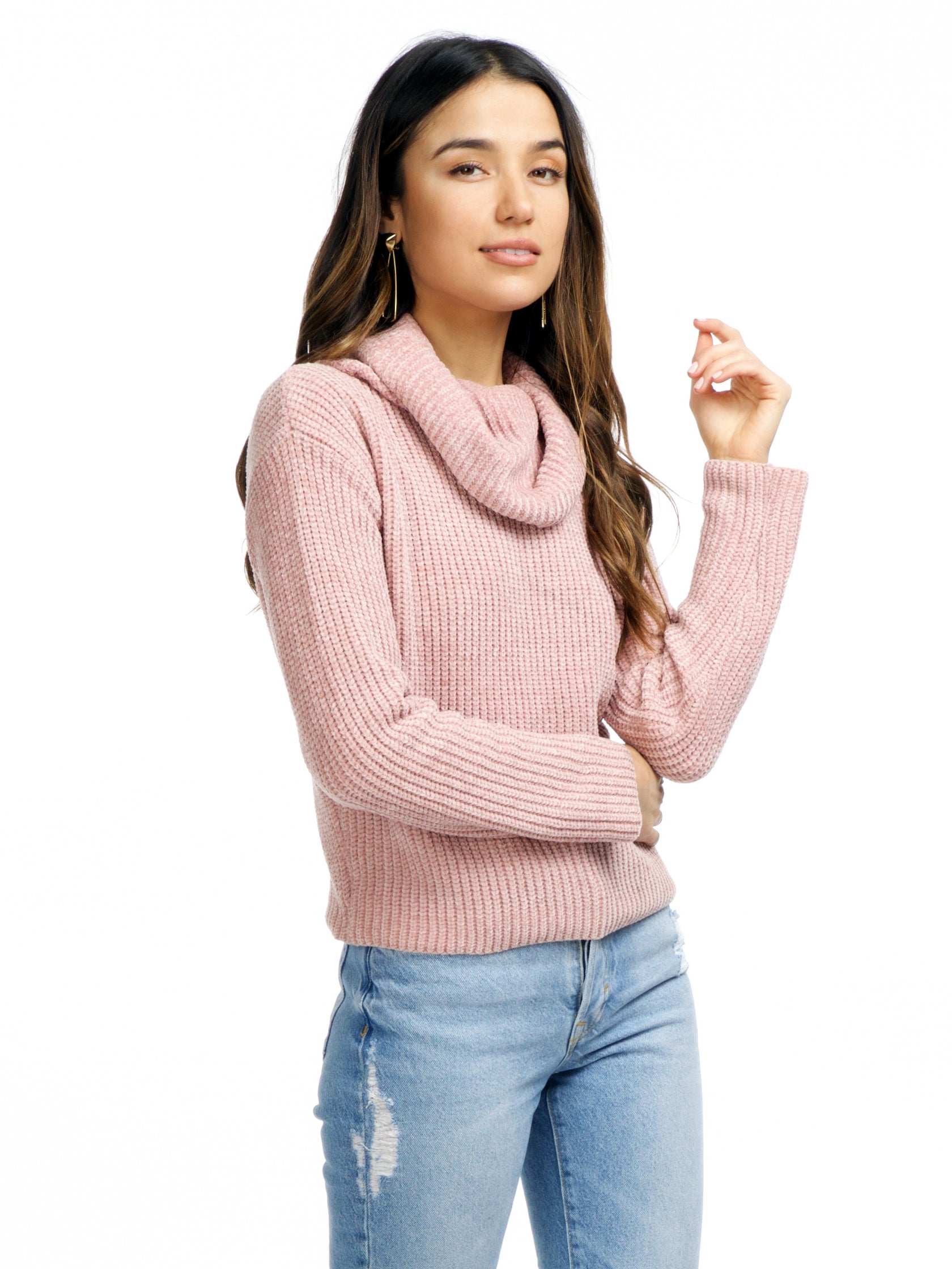Woman wearing a sweater rental from FashionPass called Make Me Blush Sweater