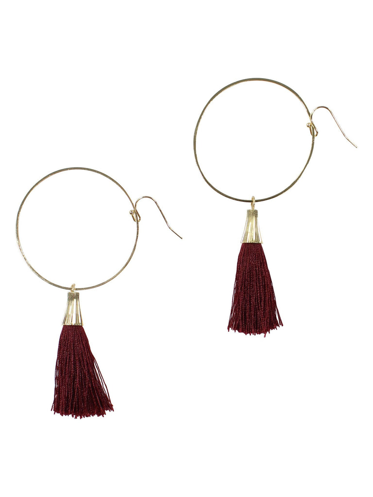 Women wearing a earrings rental from FashionPass called Sasha Hoop Tassel Earrings