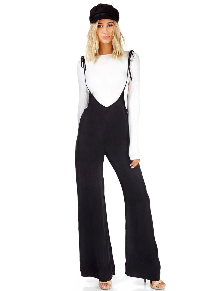 Women wearing a jumpsuit rental from FashionPass called Sunrise Crop Top