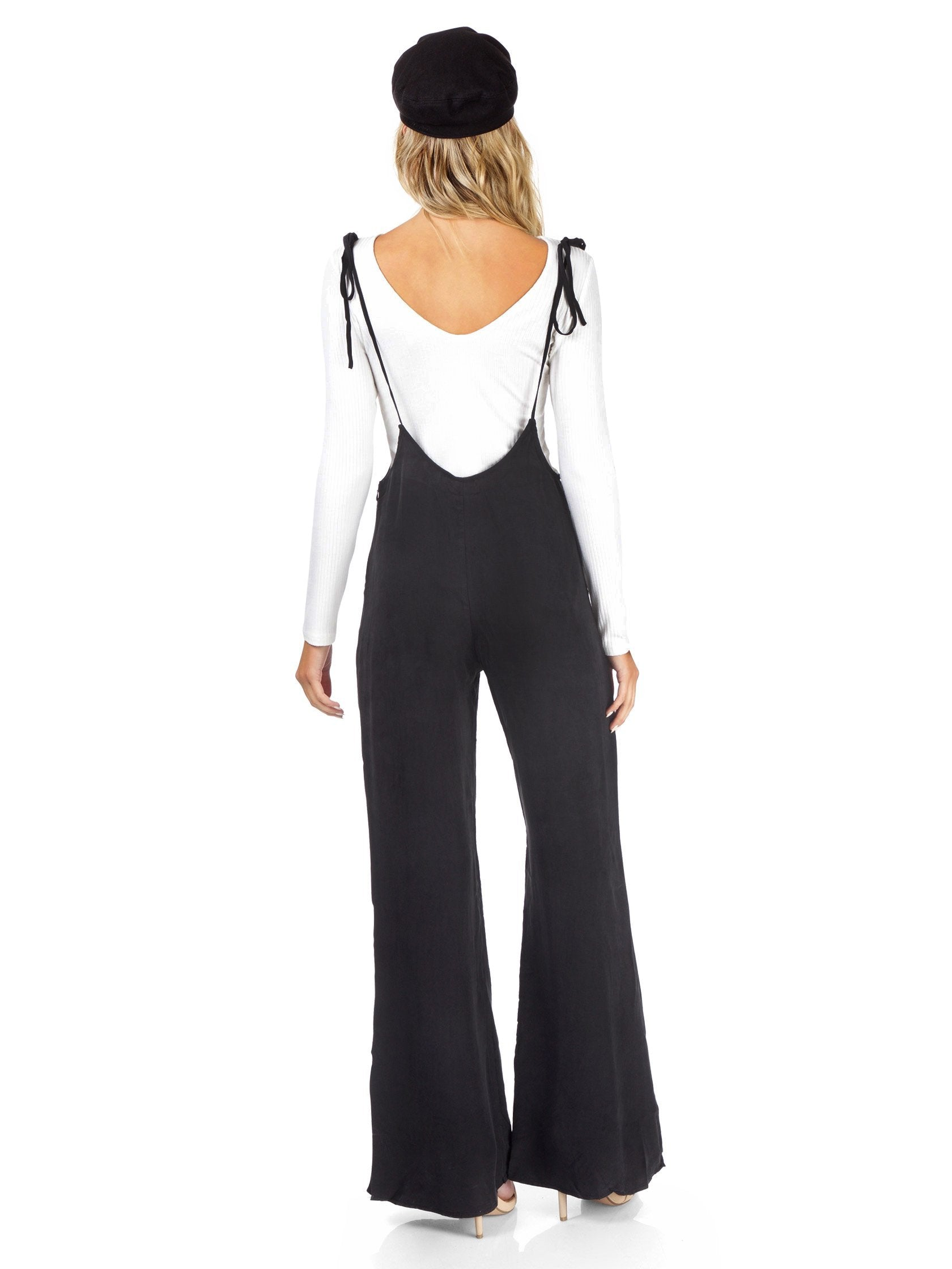 Women wearing a jumpsuit rental from FashionPass called Sasha Jumpsuit