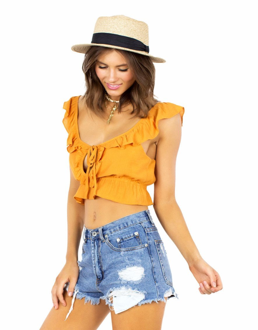 Women wearing a top rental from FashionPass called Sunrise Crop Top