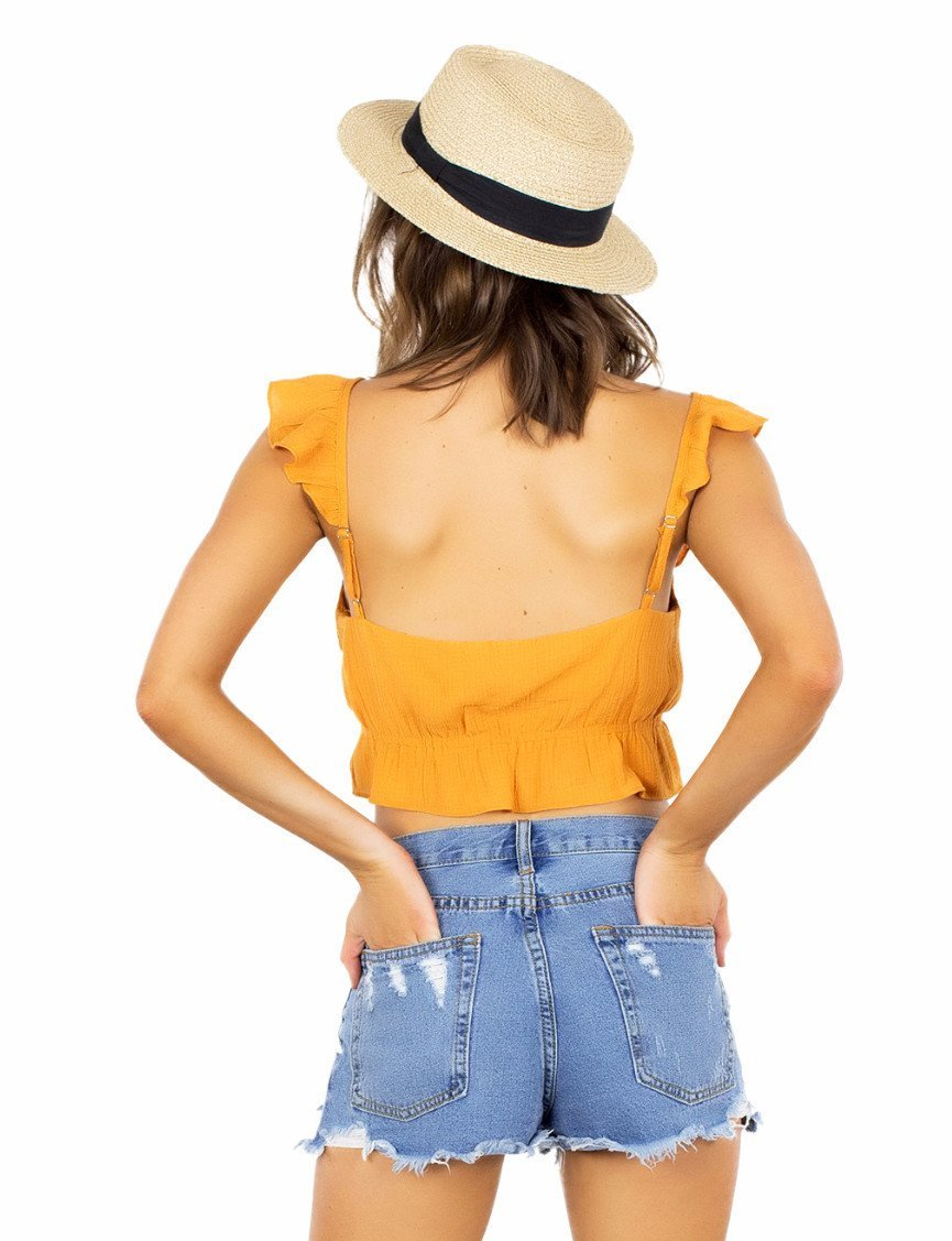 Women outfit in a top rental from FashionPass called Sunrise Crop Top