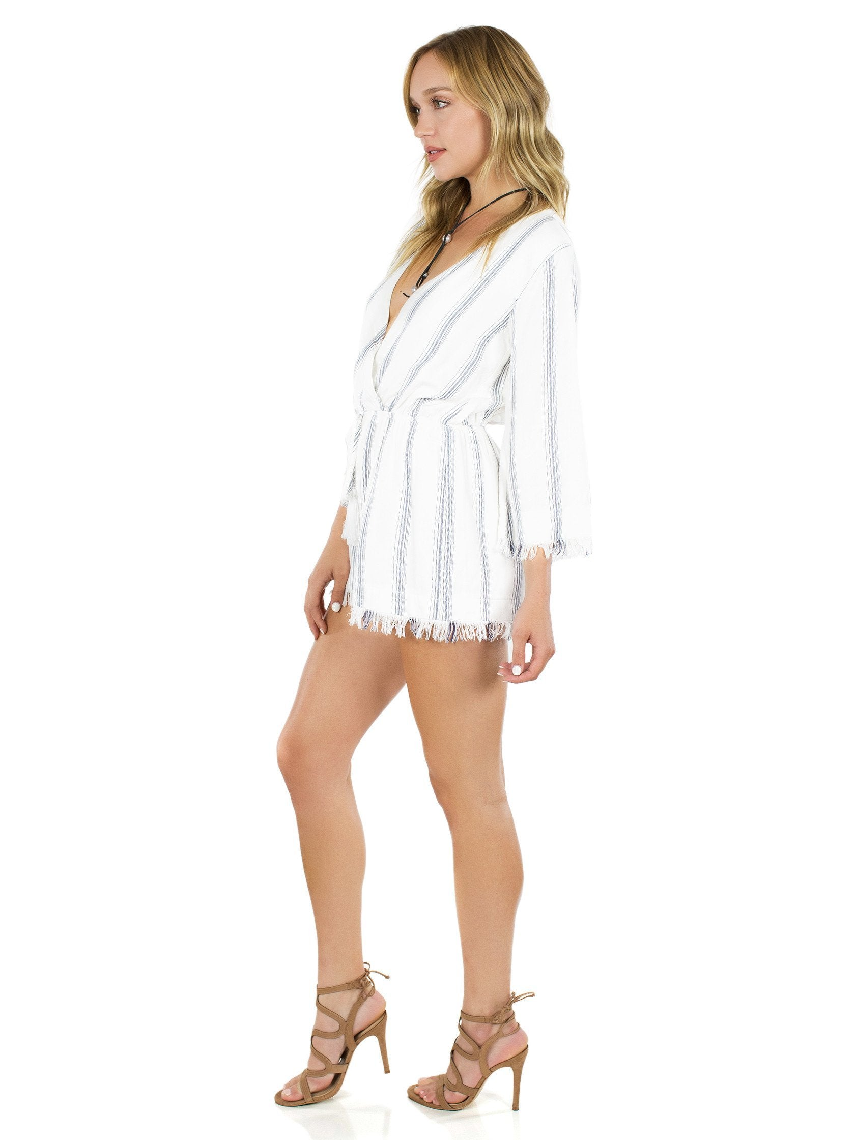 Woman wearing a romper rental from FashionPass called Take Me To Tulum Romper