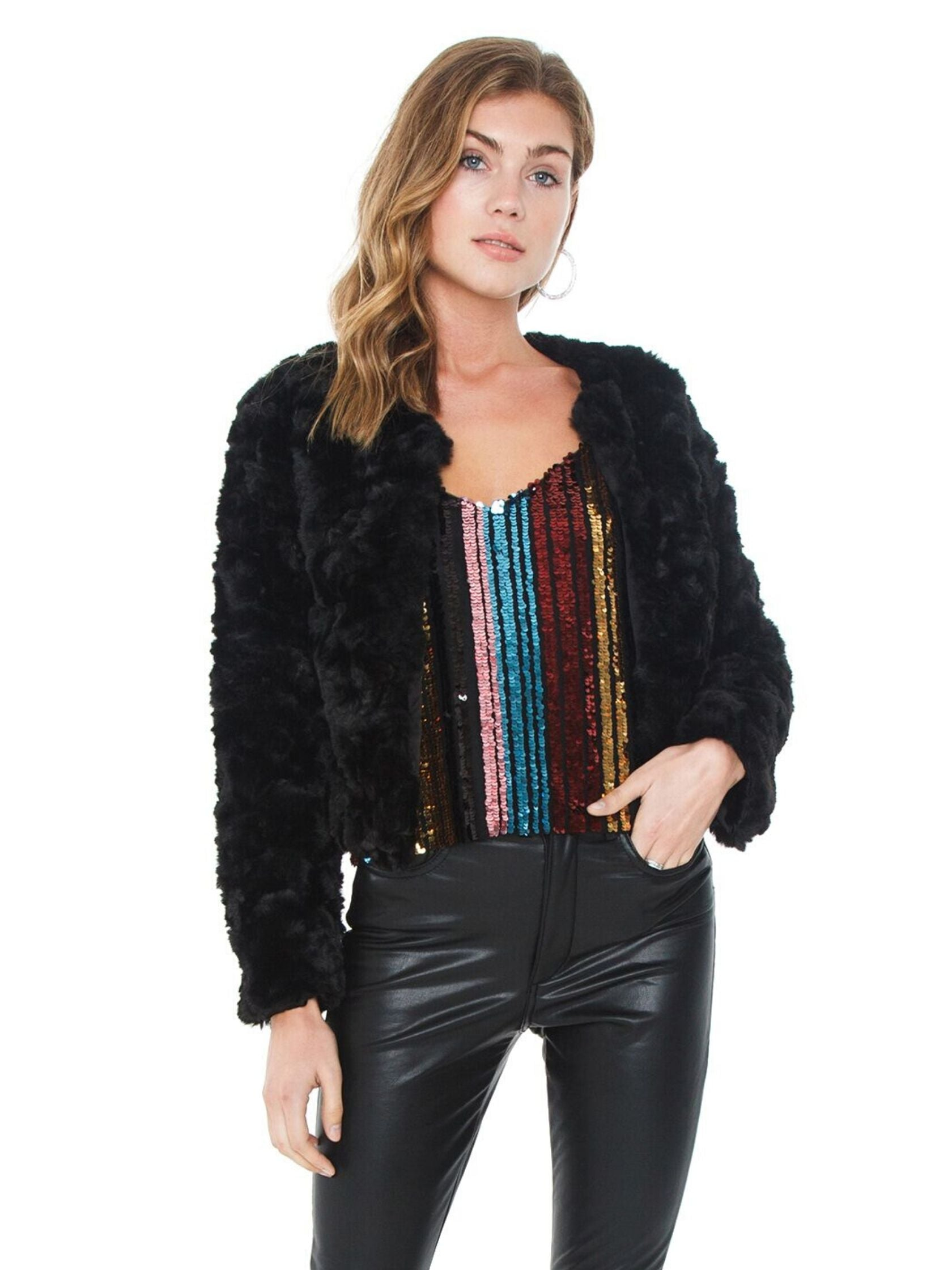 Woman wearing a jacket rental from Line & Dot called Faux Fur Jacket