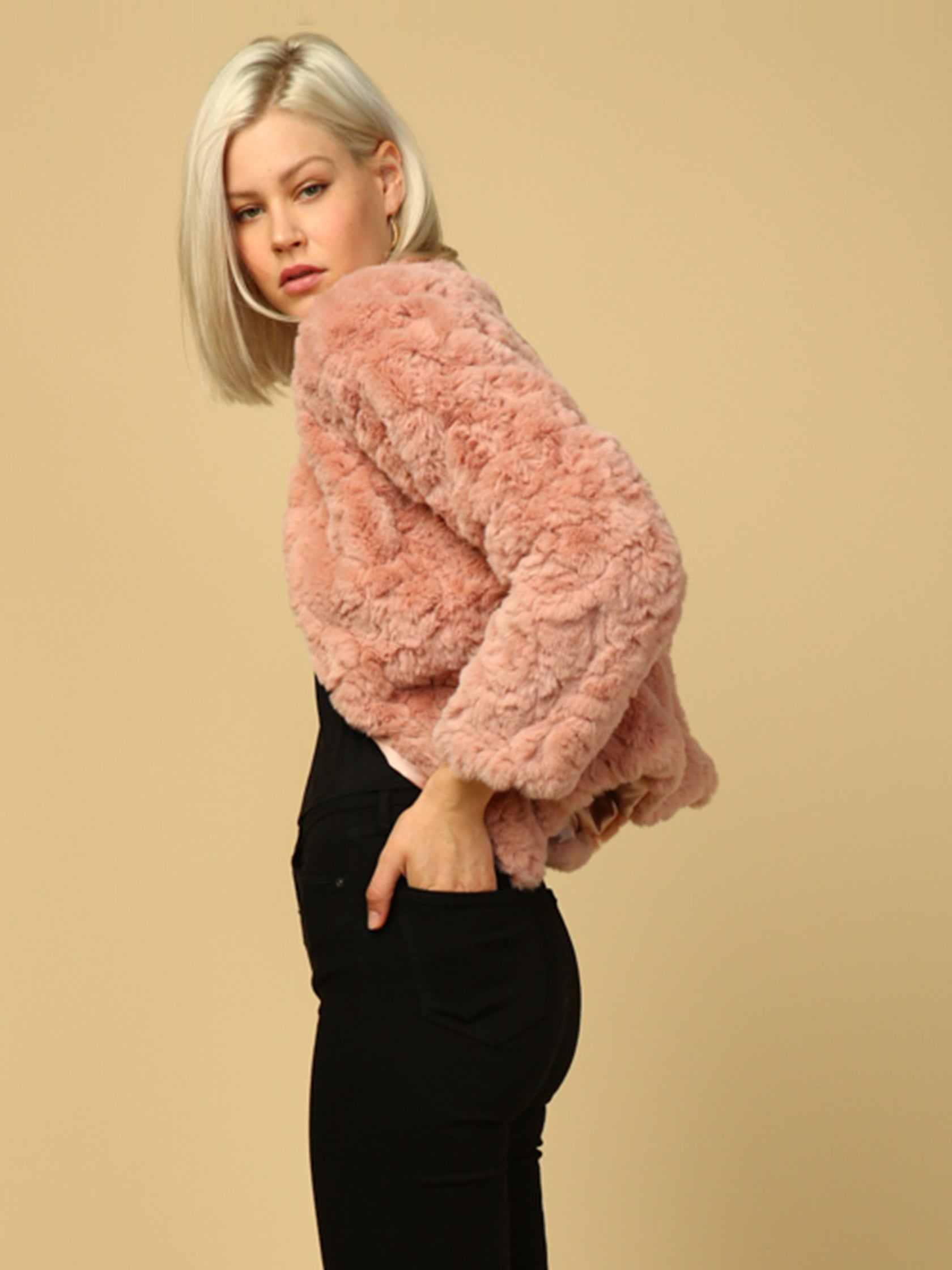 Women wearing a jacket rental from Line & Dot called Faux Fur Jacket