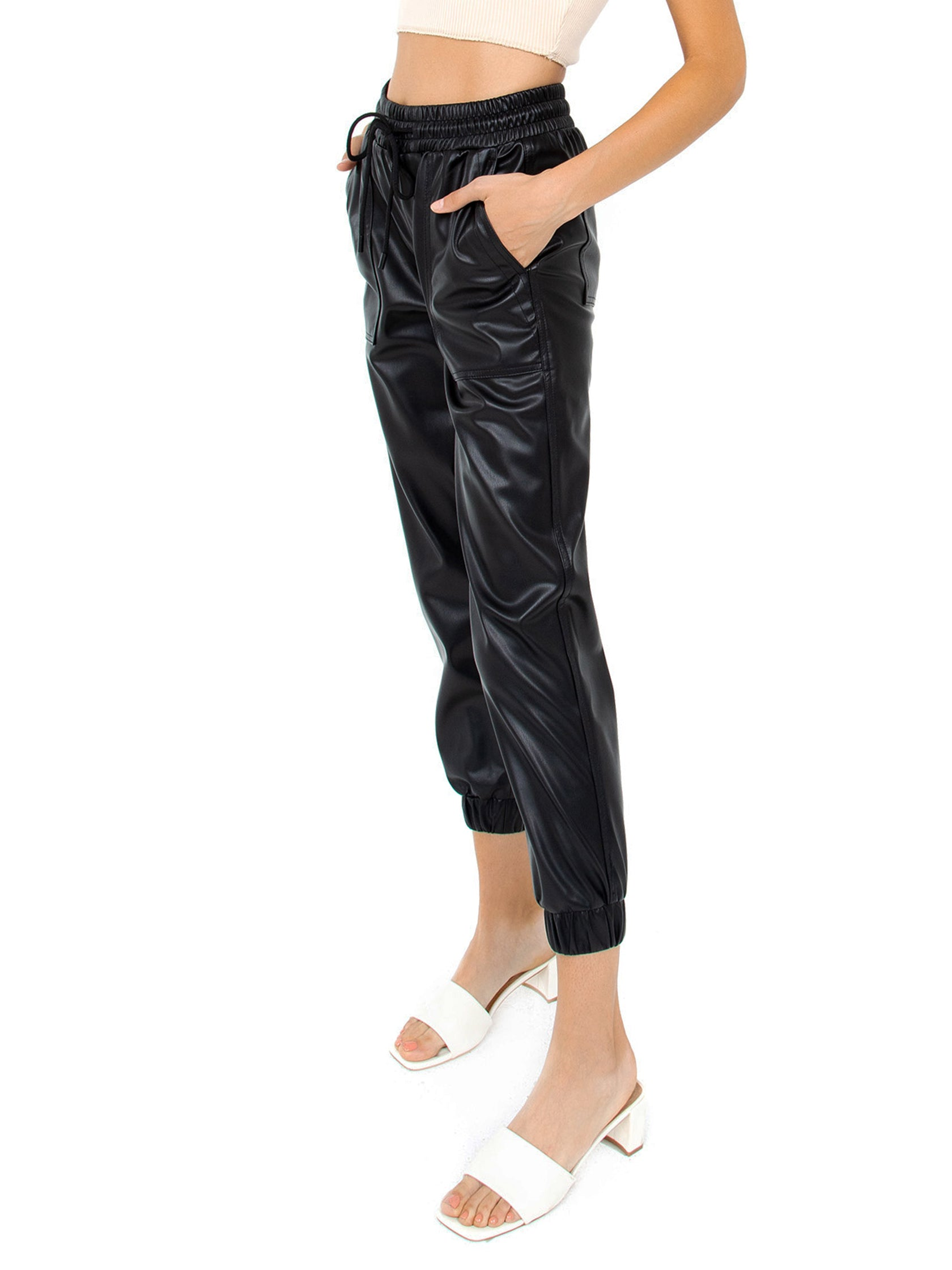 Women wearing a pants rental from BLANKNYC called Faux Leather Jogger