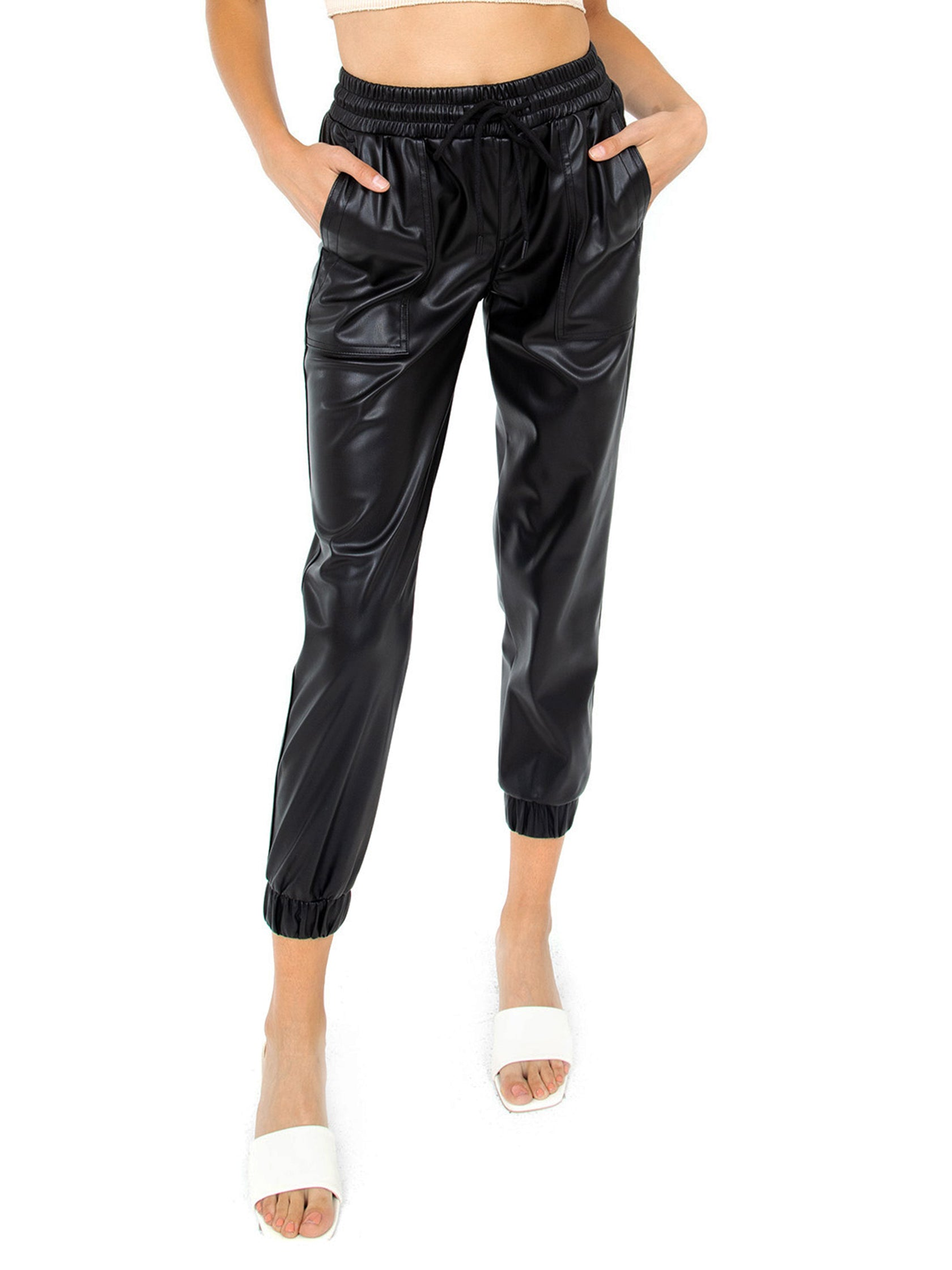 Woman wearing a pants rental from BLANKNYC called Faux Leather Jogger