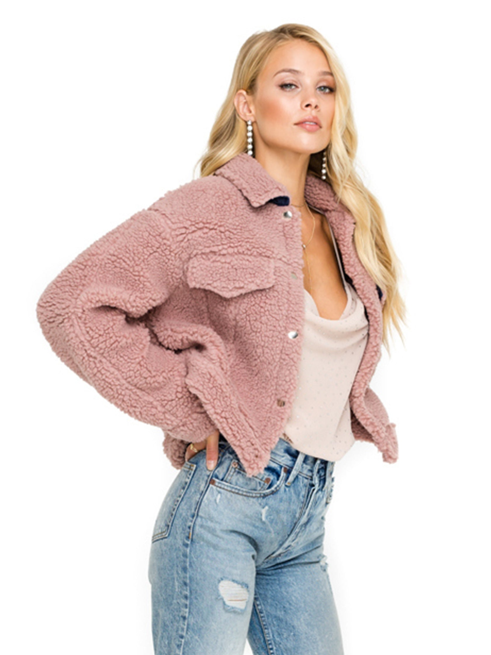 Women wearing a jacket rental from ASTR called Faux Shearling Trucker Jacket