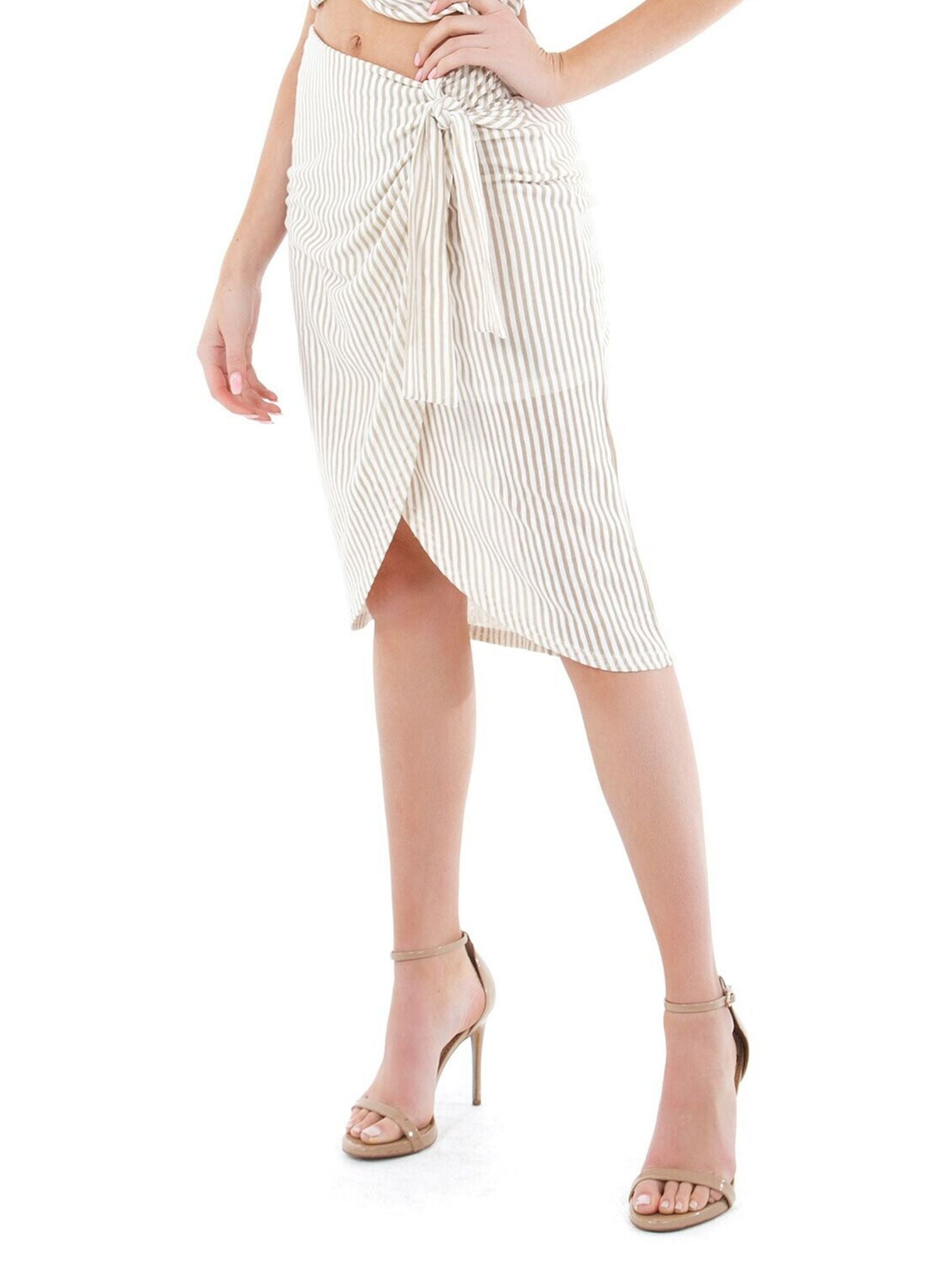 Women wearing a skirt rental from MINKPINK called Faux Wrap Midi Skirt