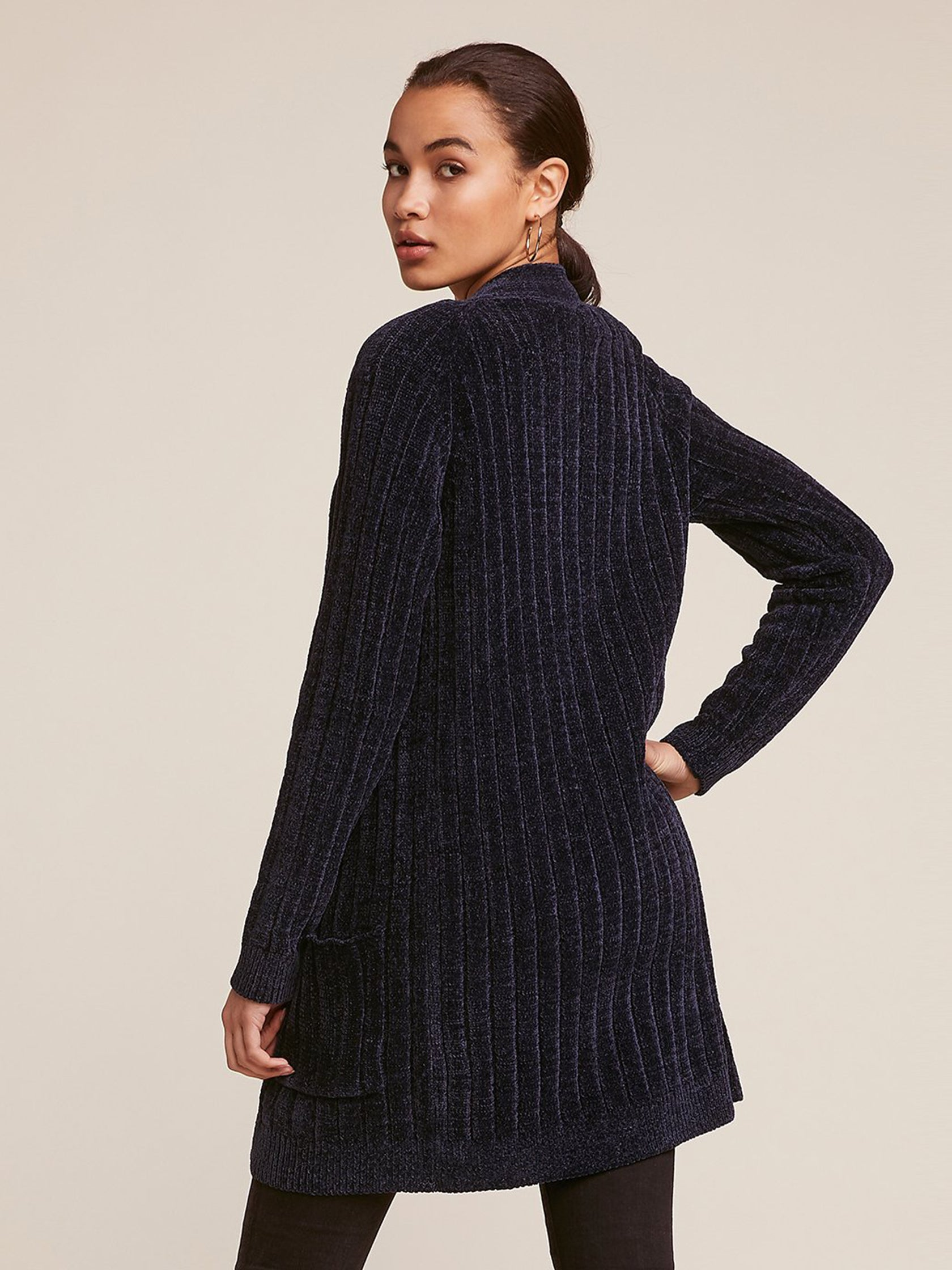 Women wearing a cardigan rental from BB Dakota called Favorite Game Knee Length Cardigan