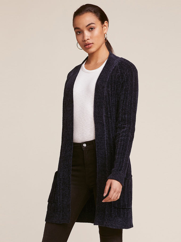 Woman wearing a cardigan rental from BB Dakota called I've Been Busy Long Cardigan