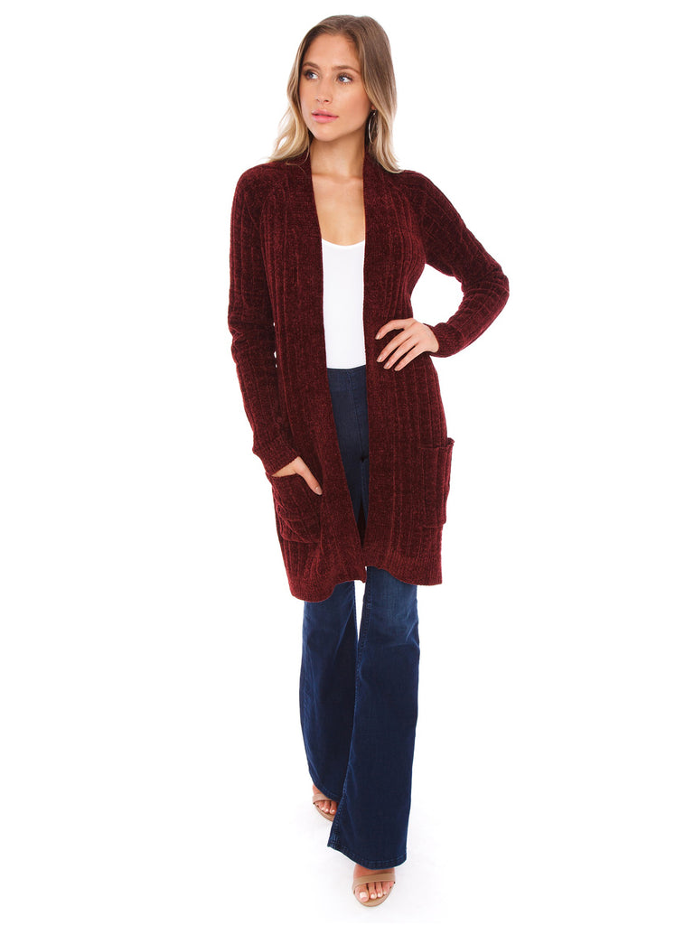 Woman wearing a cardigan rental from BB Dakota called Laurel Canyon Drawstring Top