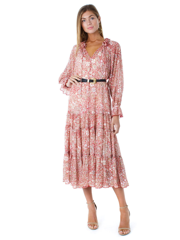 Woman wearing a dress rental from Free People called The Ana Black Floral Print Button-up Top