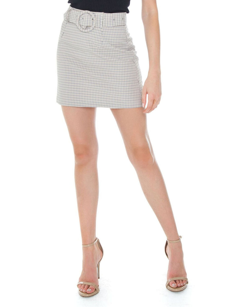 Woman wearing a skirt rental from Charlie Holiday called Elle Linen Blazer