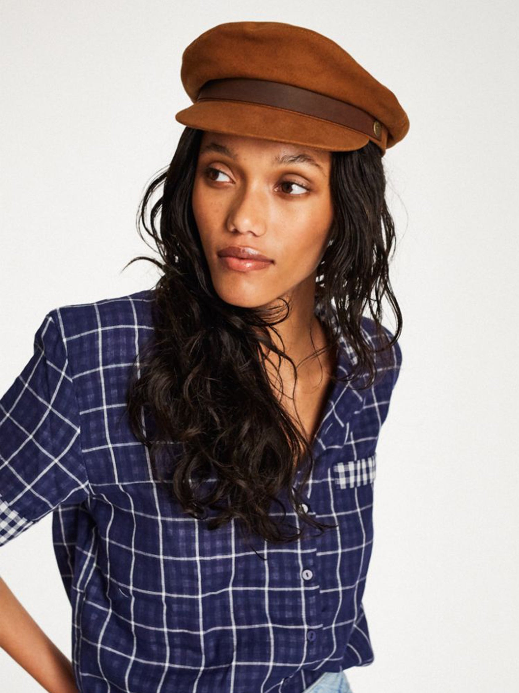 5eb1001a6a7ec Girl wearing a hat rental from Brixton called Fiddler Cap