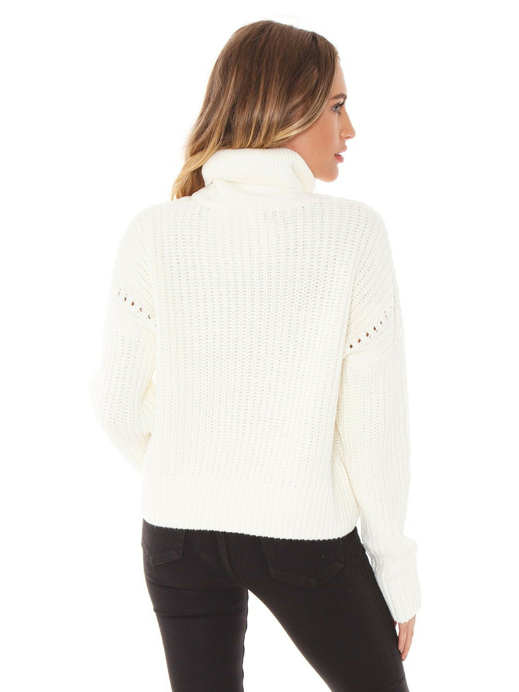 Women outfit in a sweater rental from Bishop + Young called Fireside Cropped Sweater