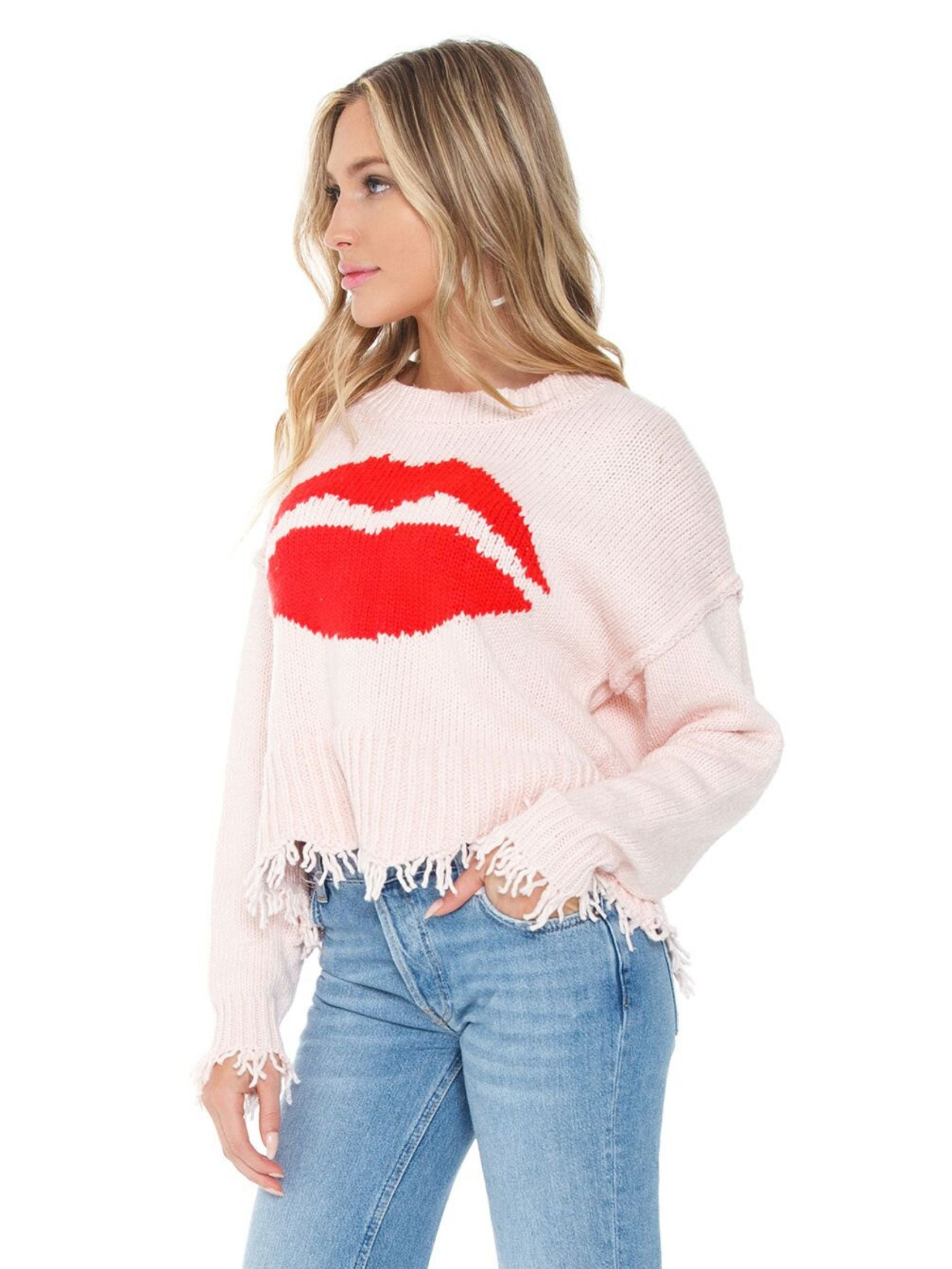 Women wearing a sweater rental from Wildfox called First Kiss Luna Sweater