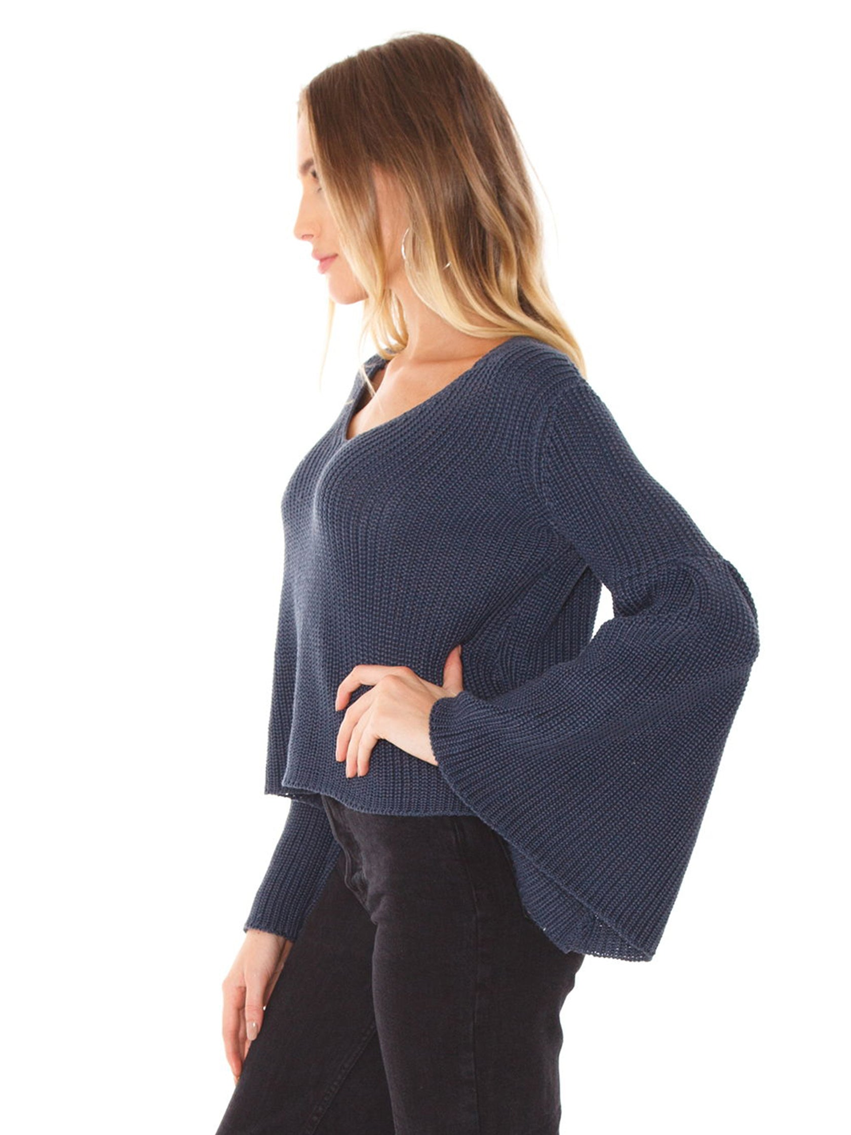 Women wearing a top rental from FashionPass called Flare Sweater