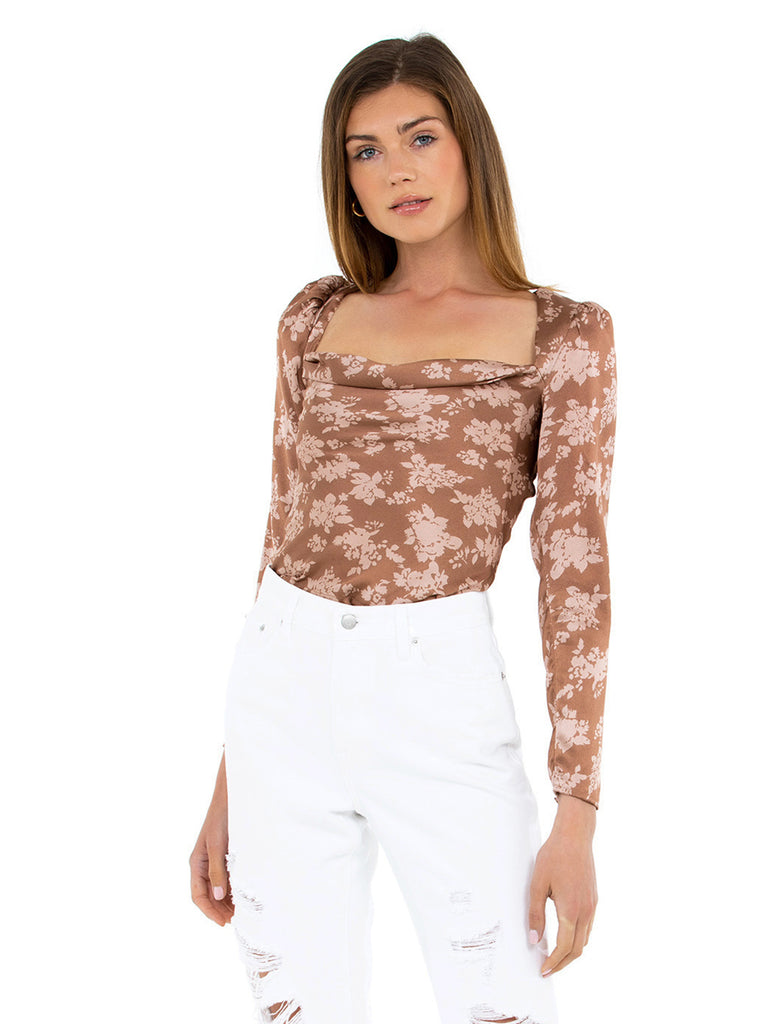 Women wearing a top rental from ASTR called Floral Long Sleeve Back Cutout Top