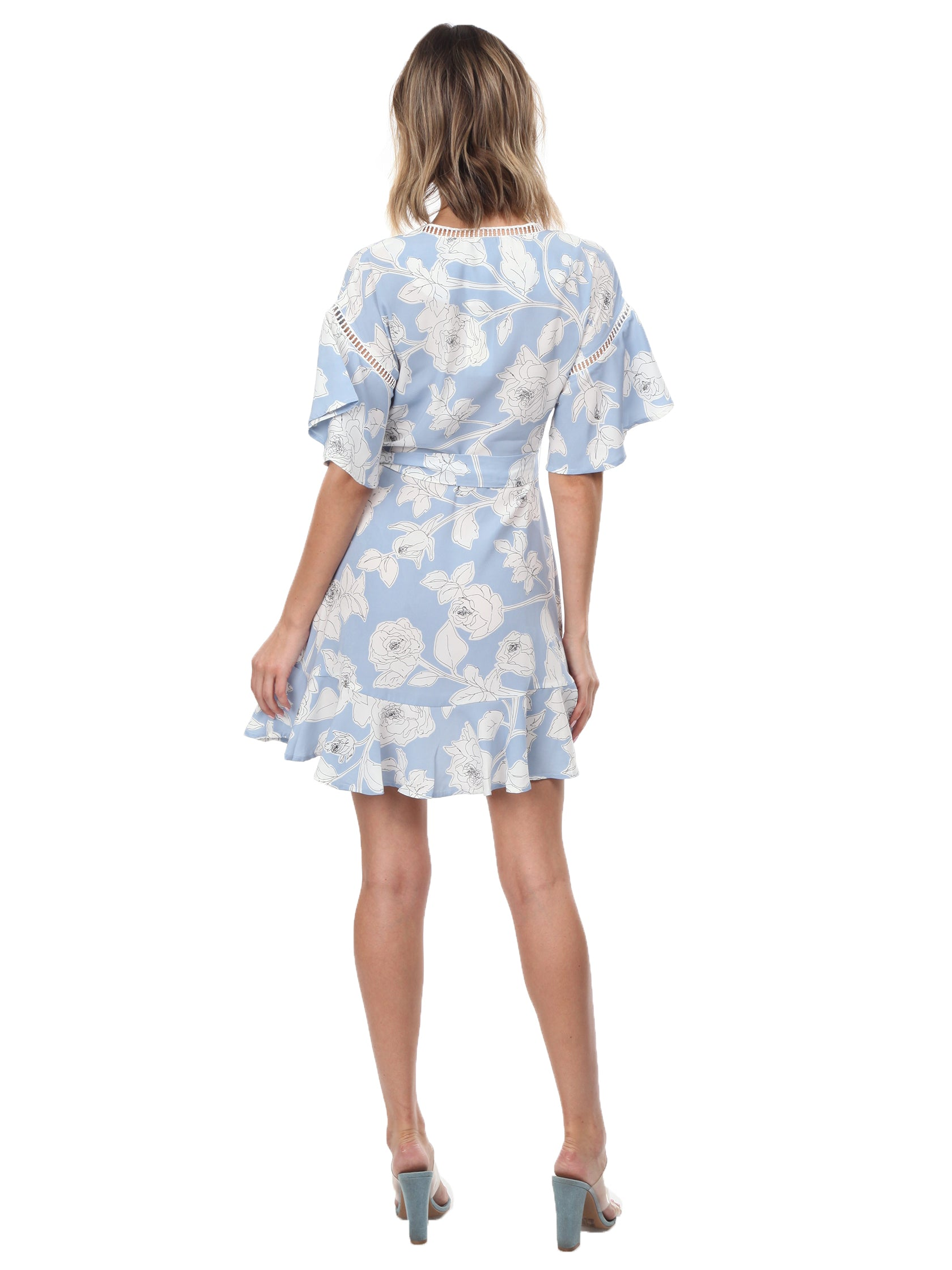 Women wearing a dress rental from Moon River called Floral Printed Wrap Dress