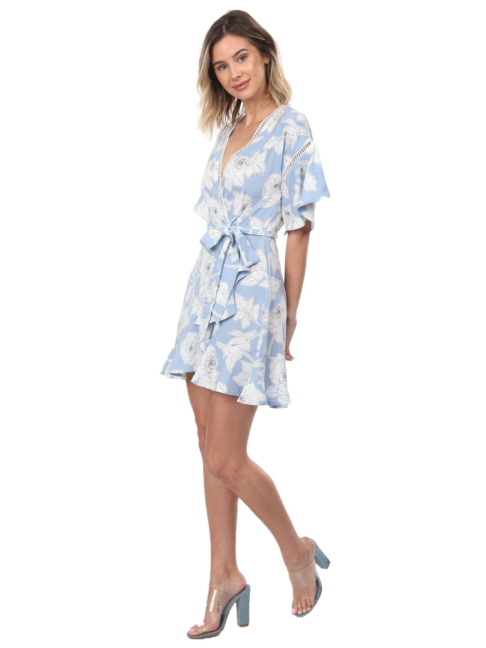Girl outfit in a dress rental from Moon River called Floral Printed Wrap Dress