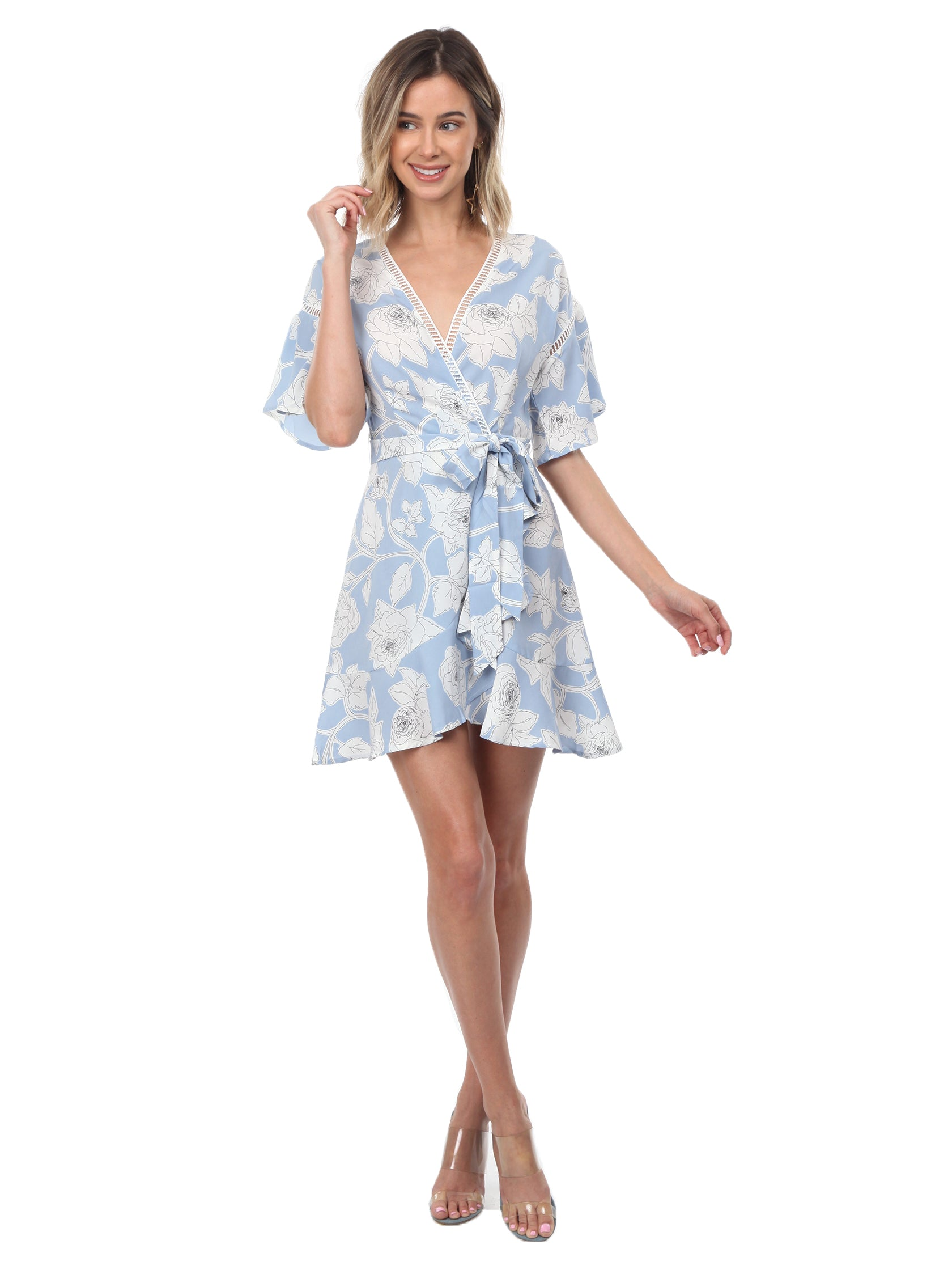 Woman wearing a dress rental from Moon River called Floral Printed Wrap Dress