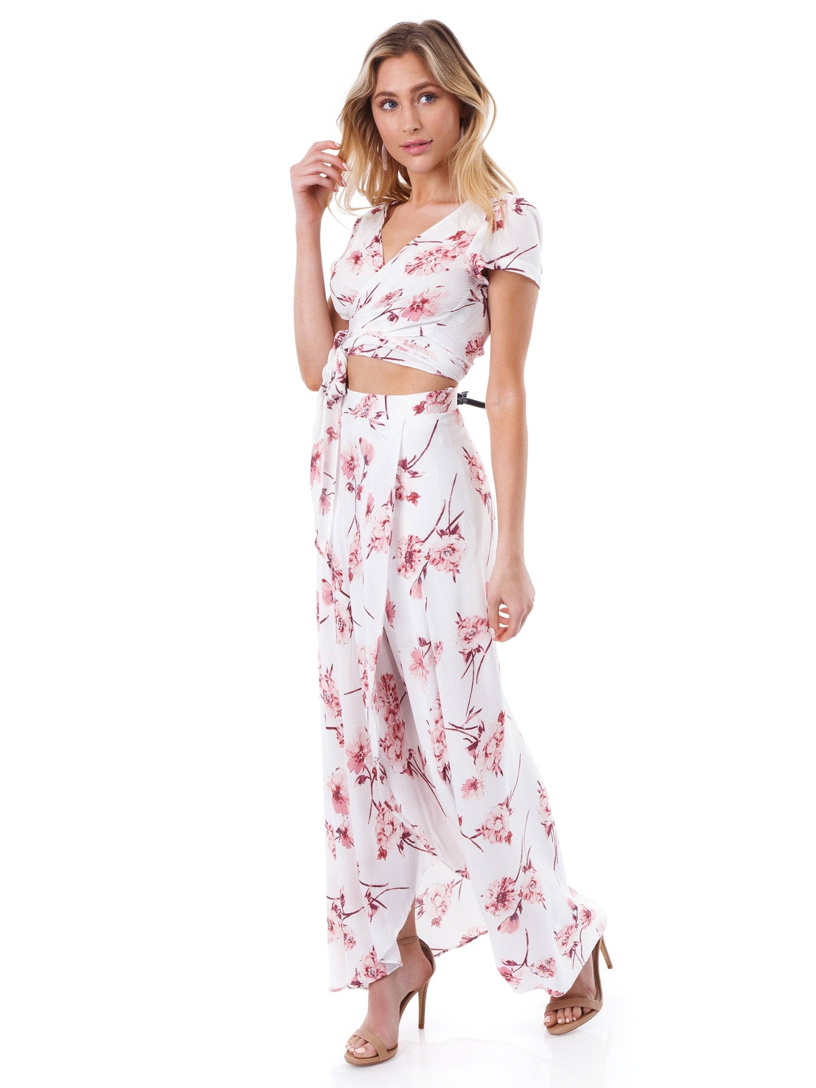 Woman wearing a two piece rental from Cotton Candy called Floral Two Piece Set