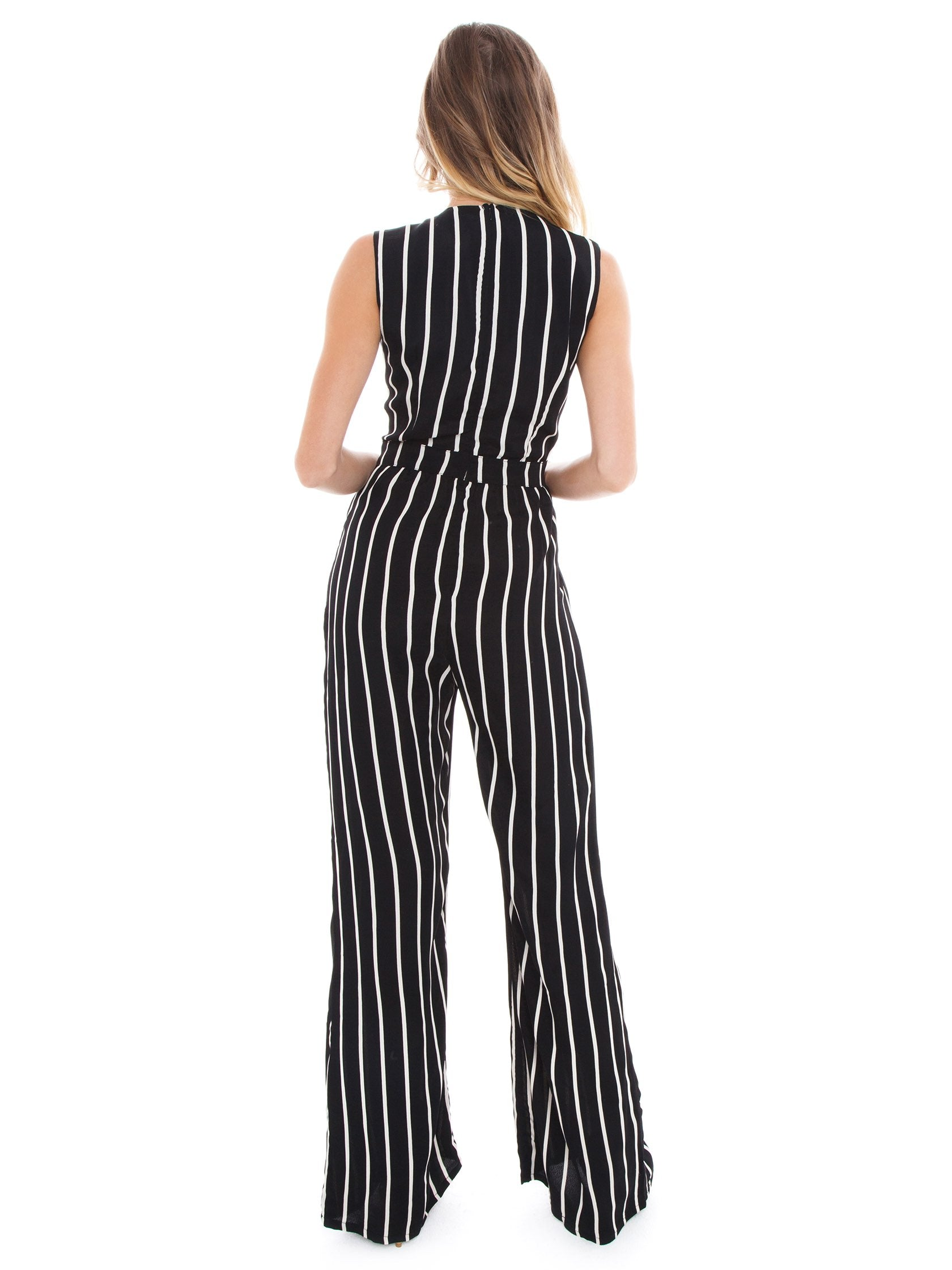 Women wearing a jumpsuit rental from Flynn Skye called Florence Jumper