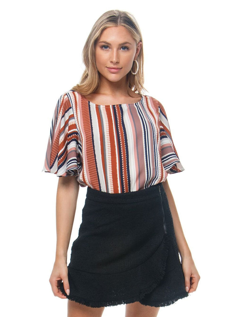 Girl wearing a top rental from BB Dakota called Tiger Lily Bell Sleeve Top