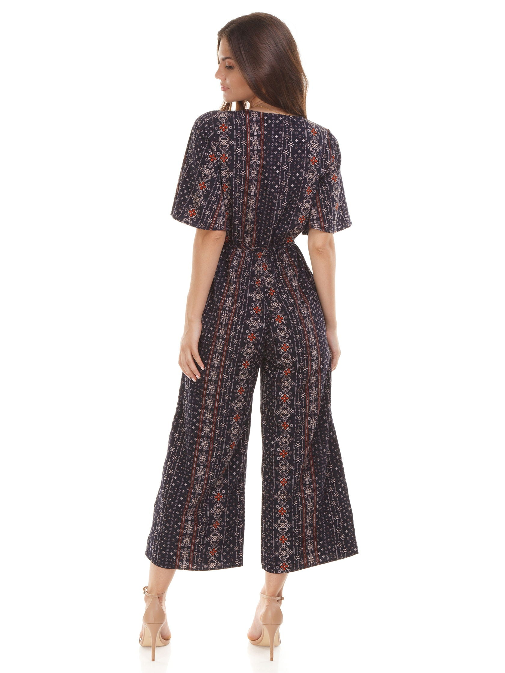Women wearing a jumpsuit rental from Moon River called Flutter Sleeve Wide Leg Jumpsuit