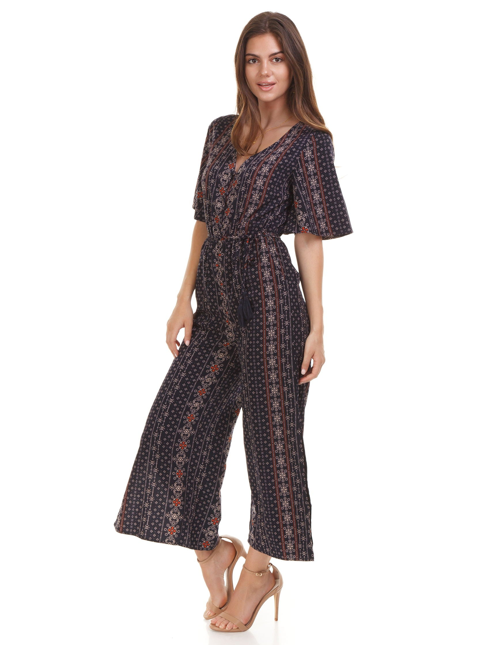 Woman wearing a jumpsuit rental from Moon River called Flutter Sleeve Wide Leg Jumpsuit