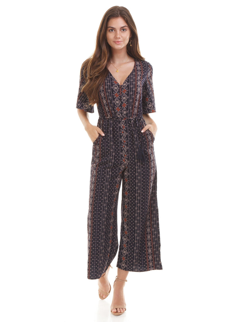Girl wearing a jumpsuit rental from Moon River called Isabel Tie Jumpsuit