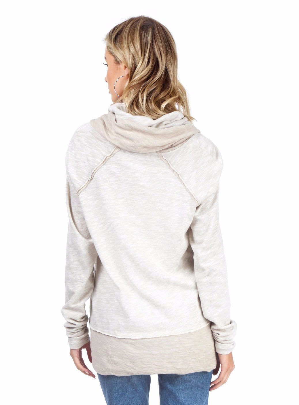Women wearing a sweater rental from Free People called Beach Cocoon Cowl Neck Pullover