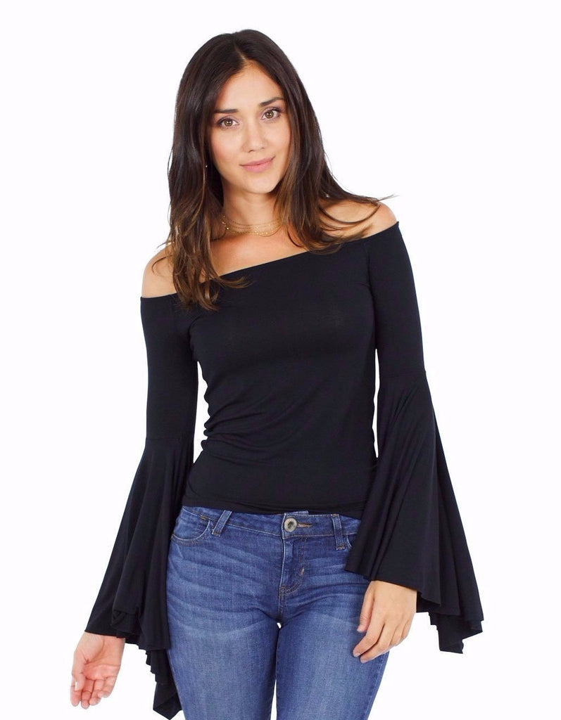 Women outfit in a top rental from Free People called V-neck Sweater