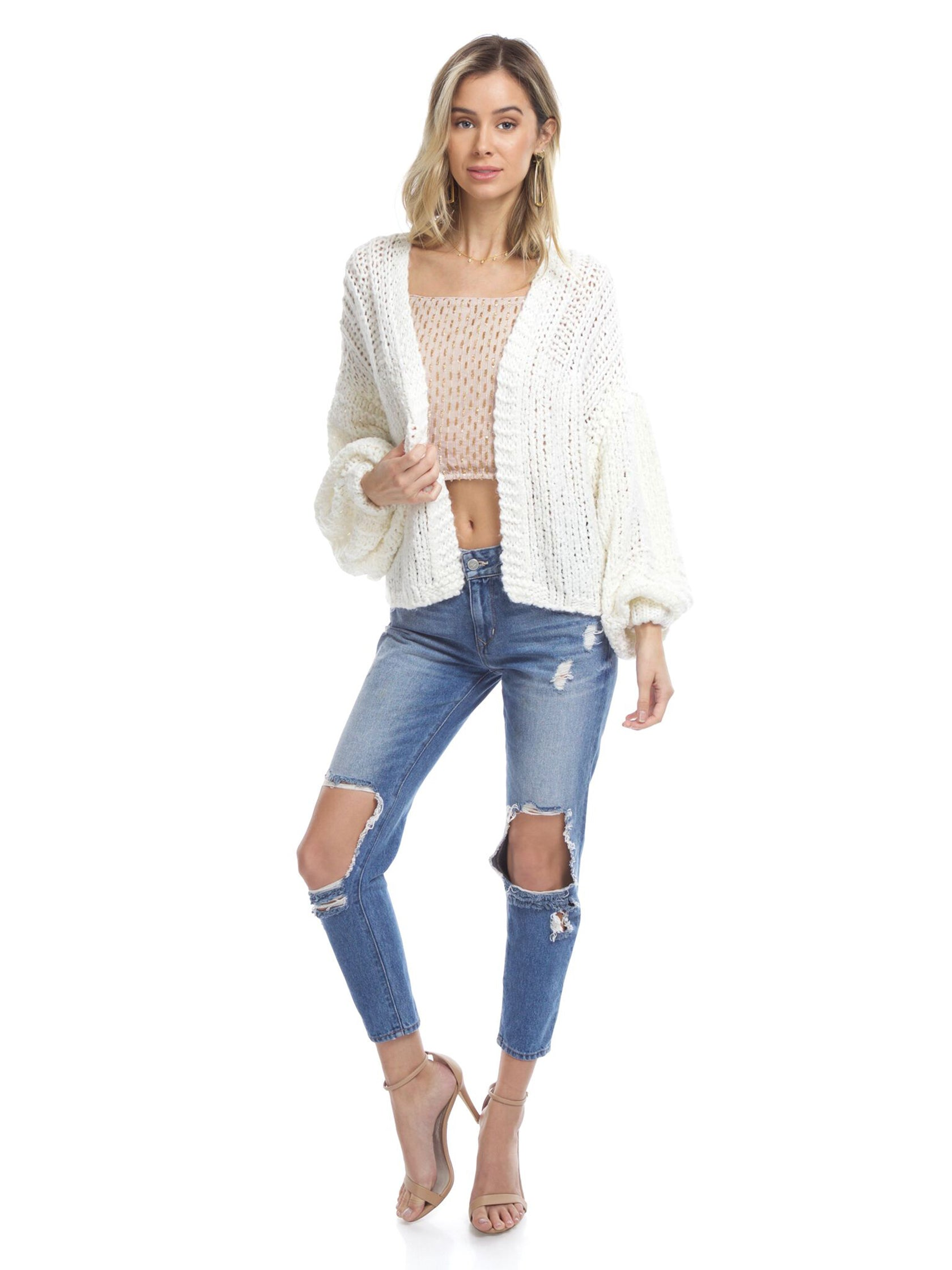 Girl wearing a cardigan rental from Free People called Chamomile Cardi