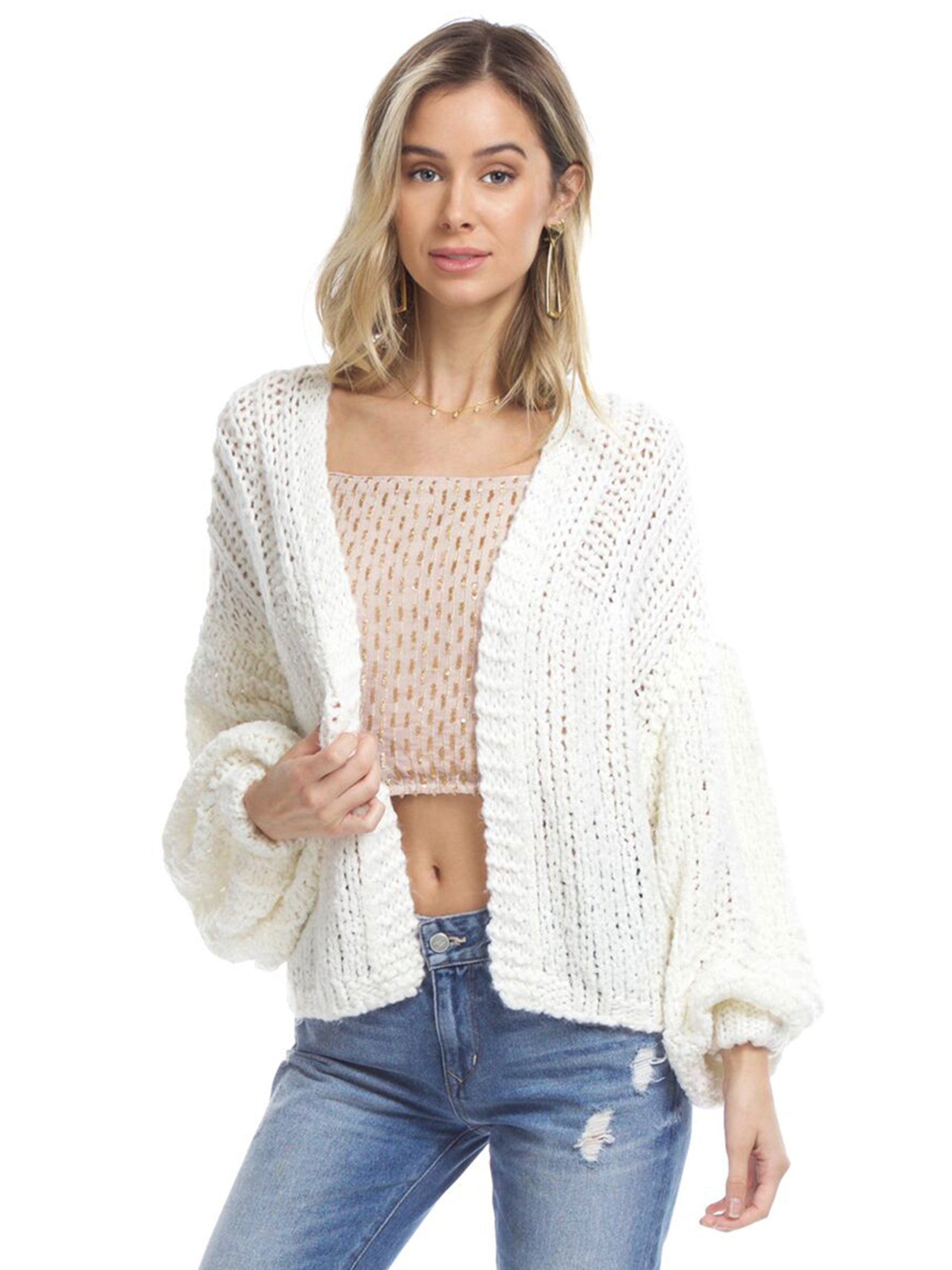 Woman wearing a cardigan rental from Free People called Chamomile Cardi