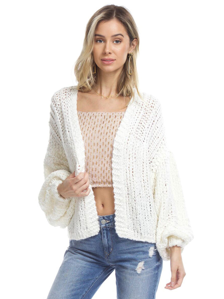 Woman wearing a cardigan rental from Free People called Cozy Up With Me Bodysuit