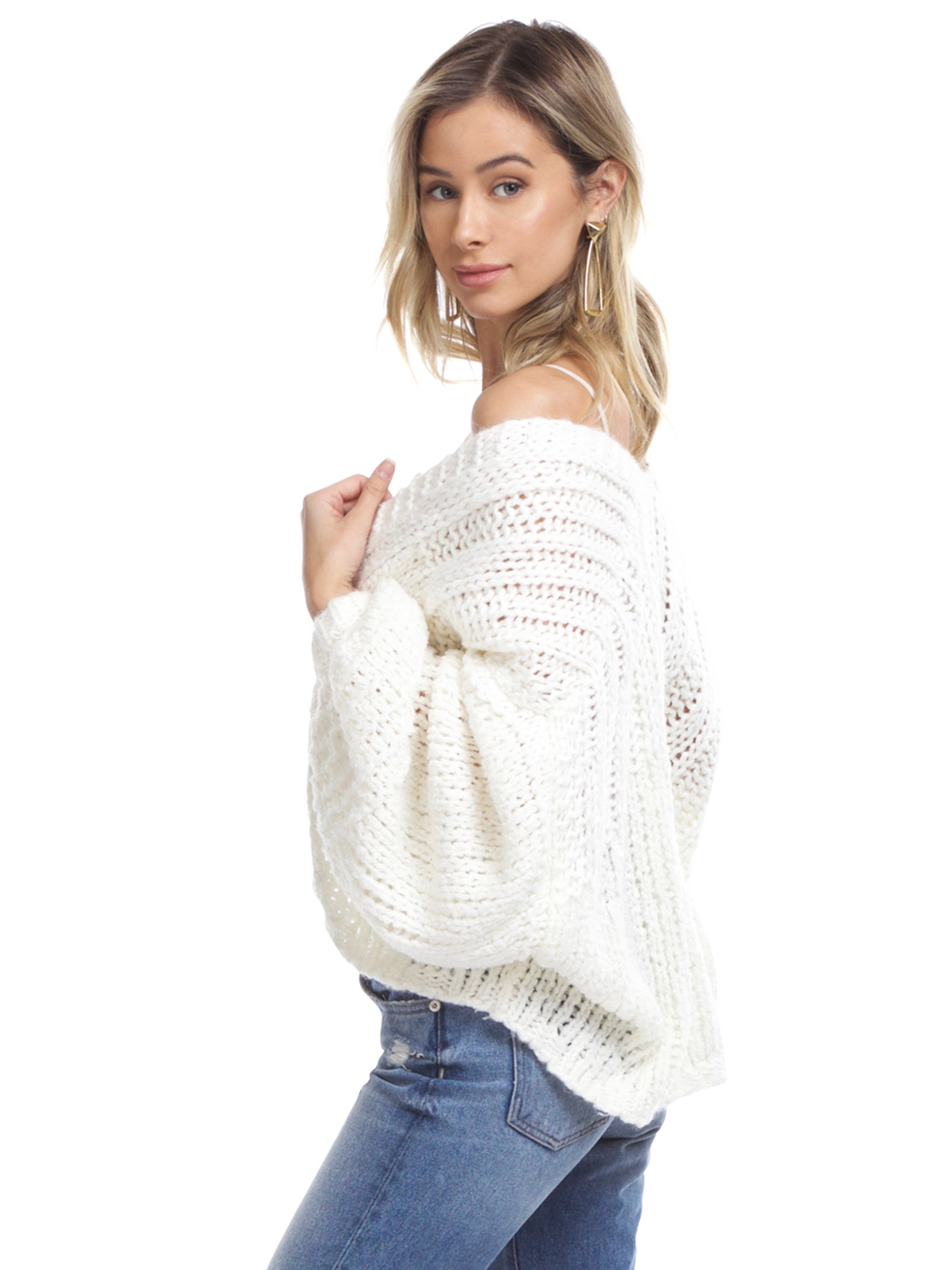 Women wearing a cardigan rental from Free People called Chamomile Cardi