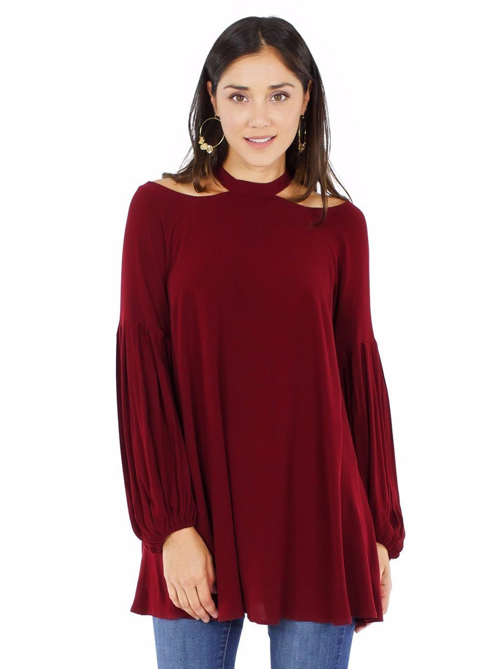 Woman wearing a top rental from Free People called Drift Away Cold Shoulder Tunic