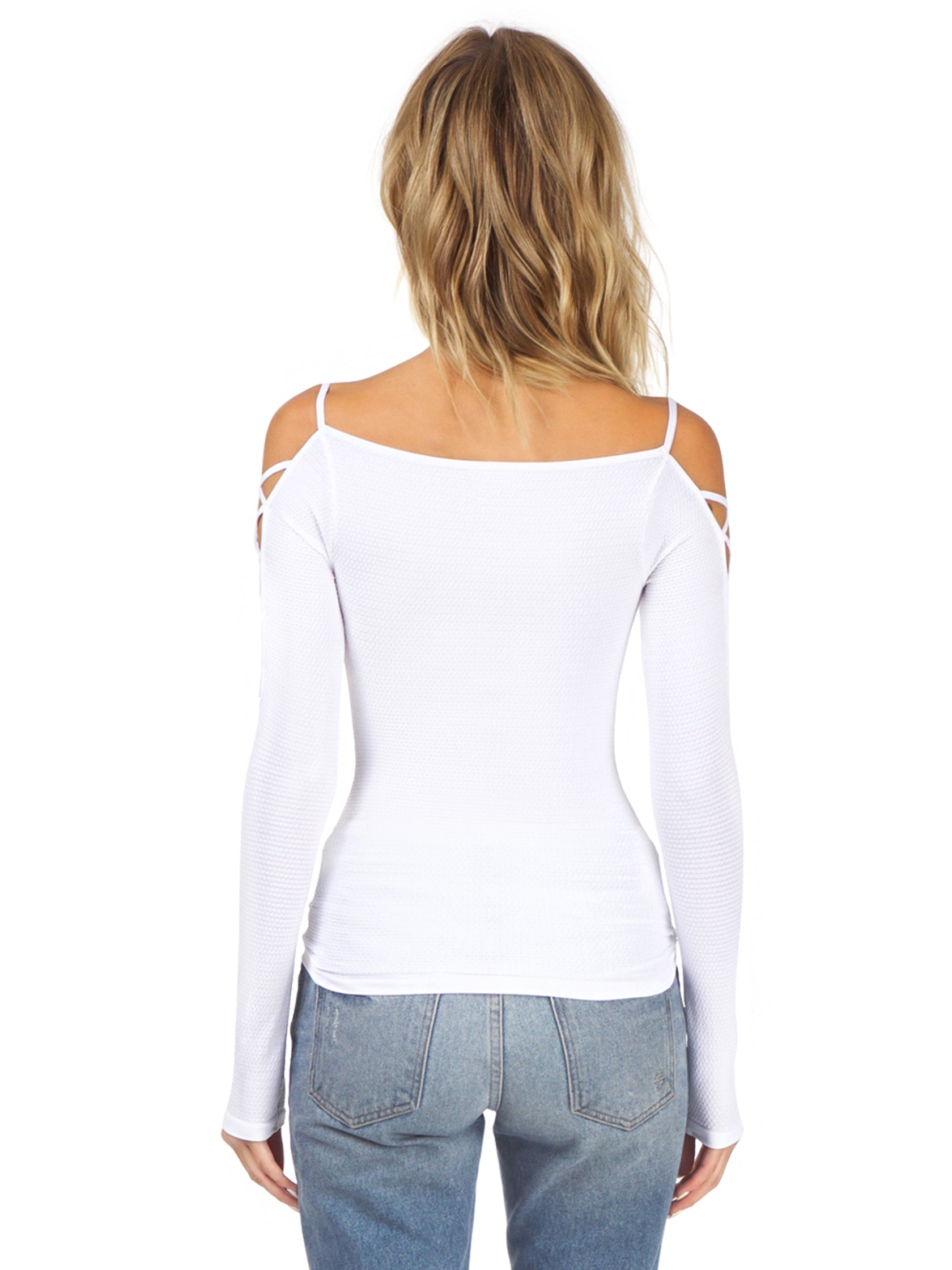 Women wearing a top rental from Free People called Cross Shoulder Top