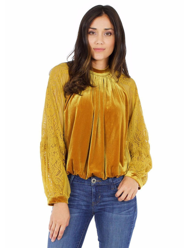 Girl wearing a top rental from Free People called Walk This Way Buttondown Top