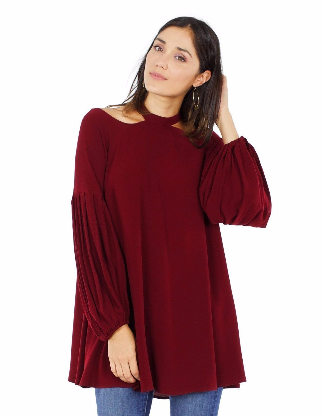 Women wearing a top rental from Free People called Drift Away Cold Shoulder Tunic