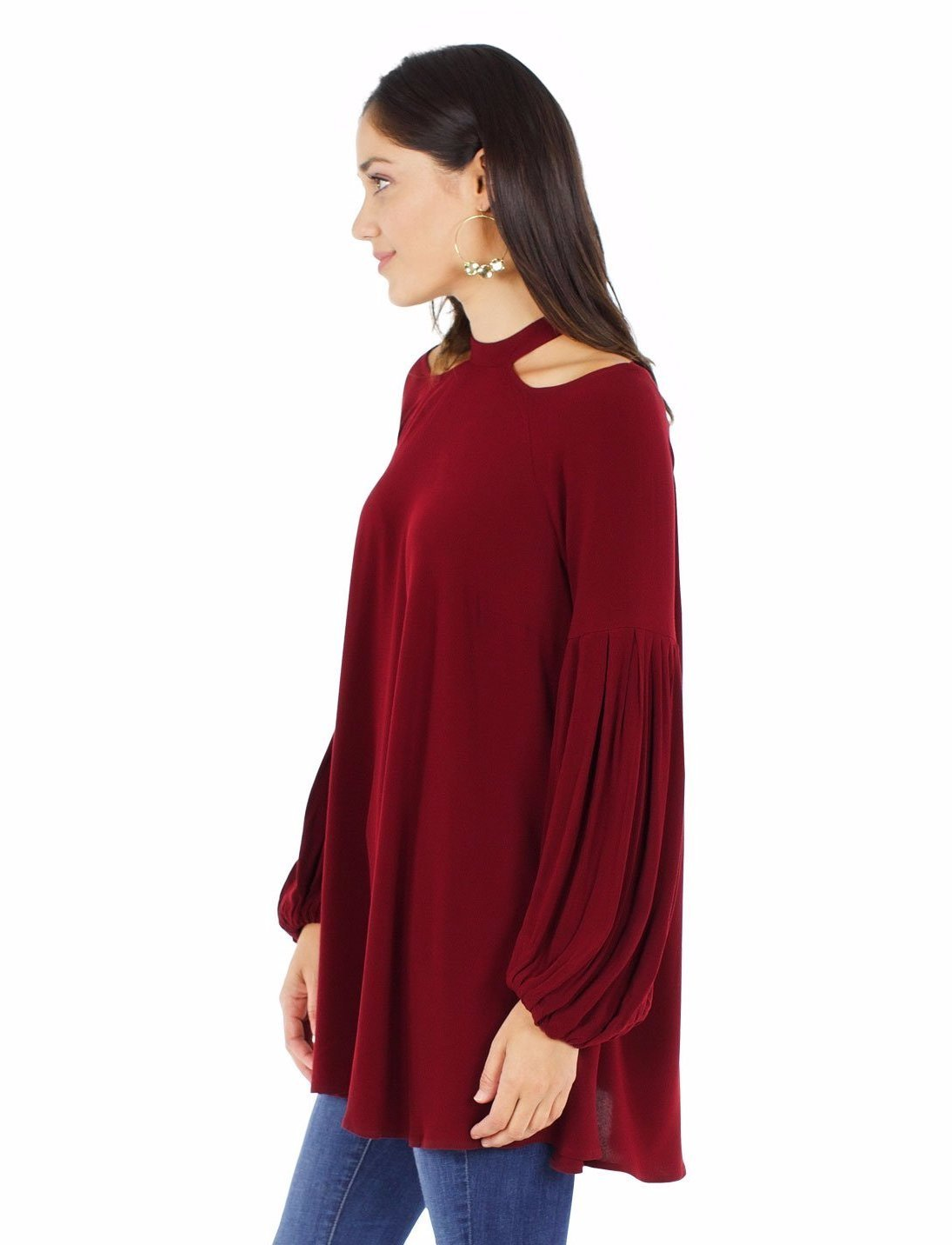 Women outfit in a top rental from Free People called Drift Away Cold Shoulder Tunic