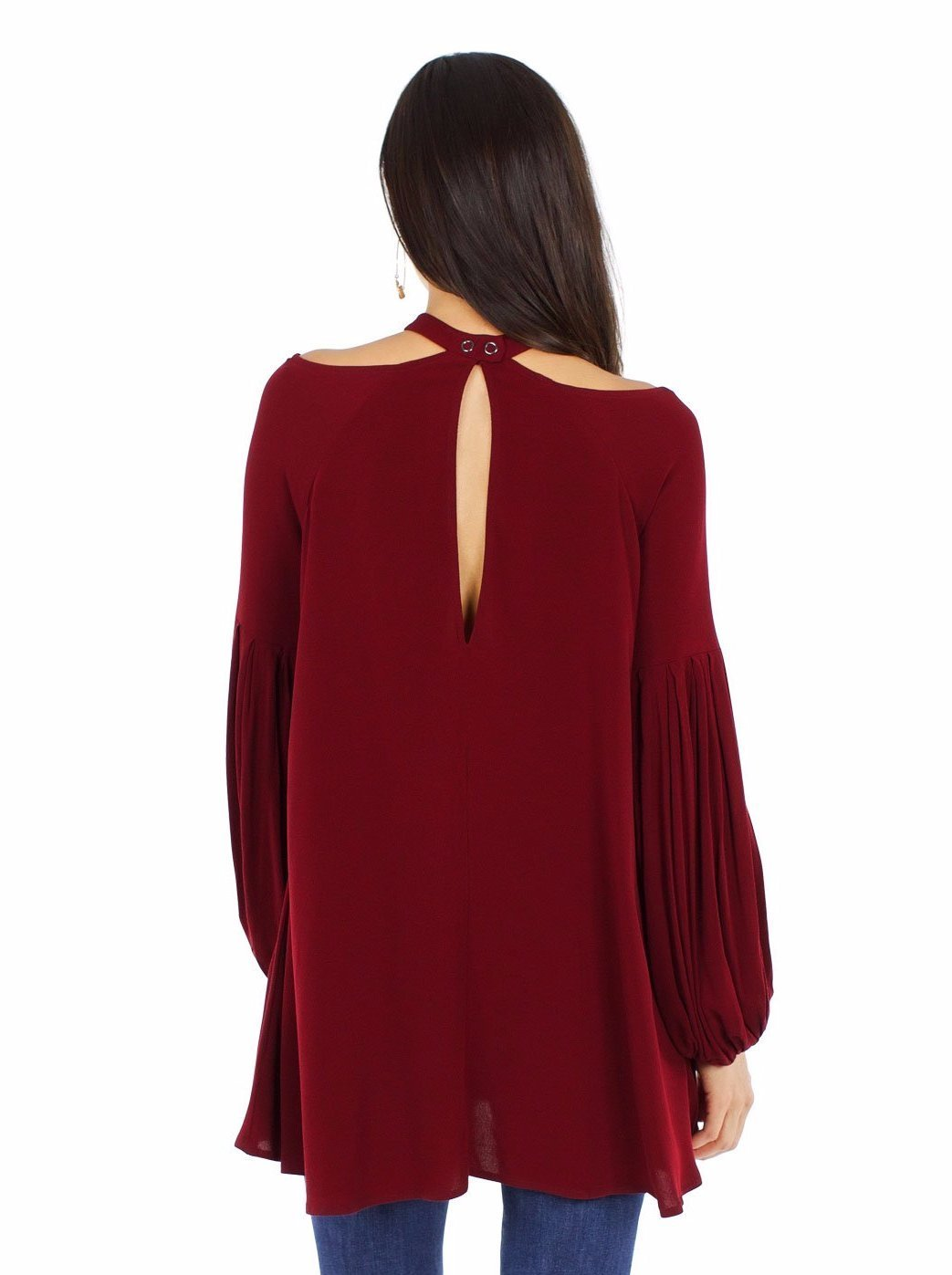 Girl wearing a top rental from Free People called Drift Away Cold Shoulder Tunic