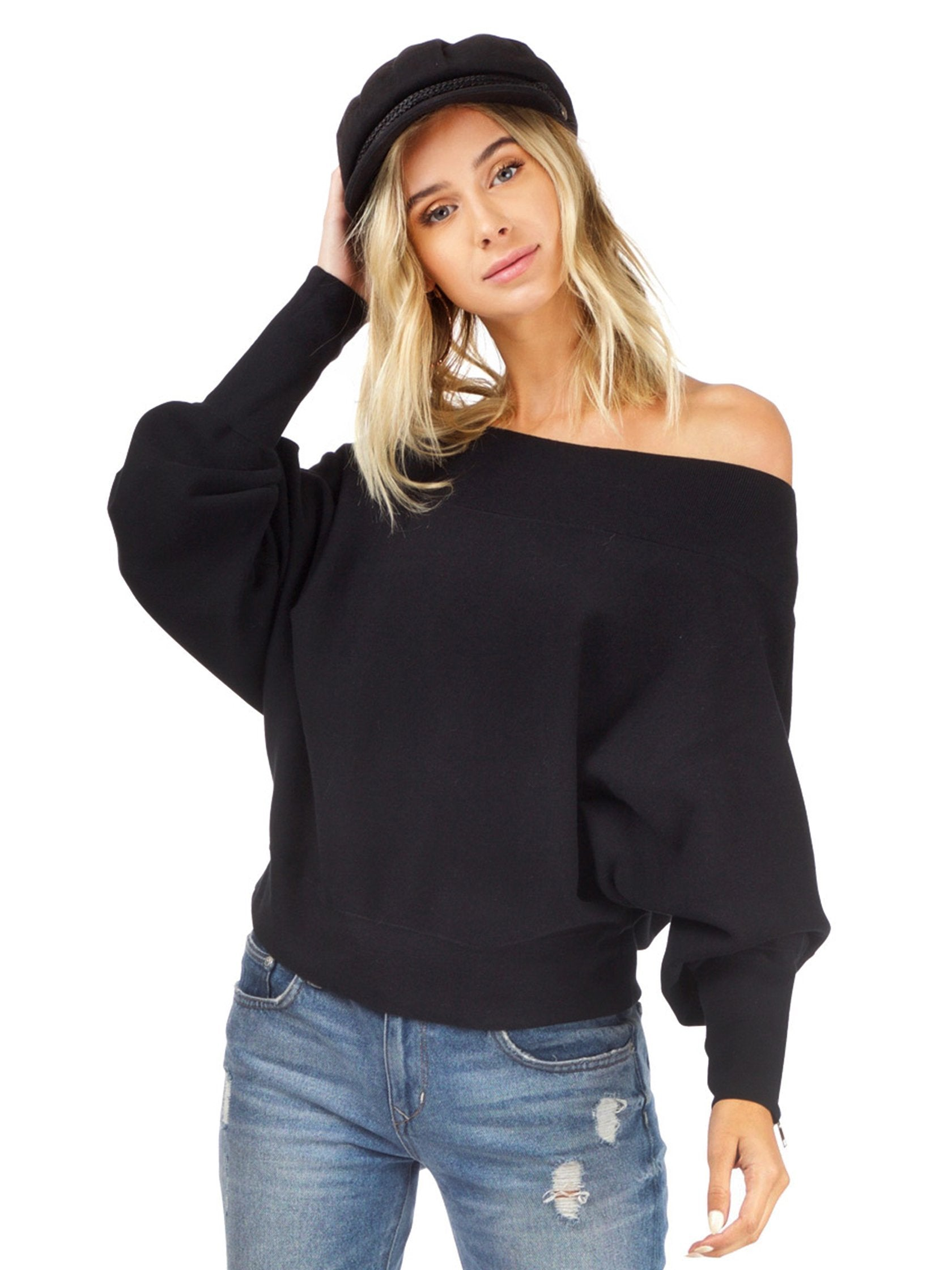 Women wearing a sweater rental from Free People called Hide And Seek Sweater