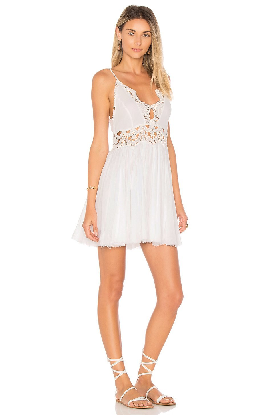 Woman wearing a dress rental from Free People called Ilektra Mini Dress