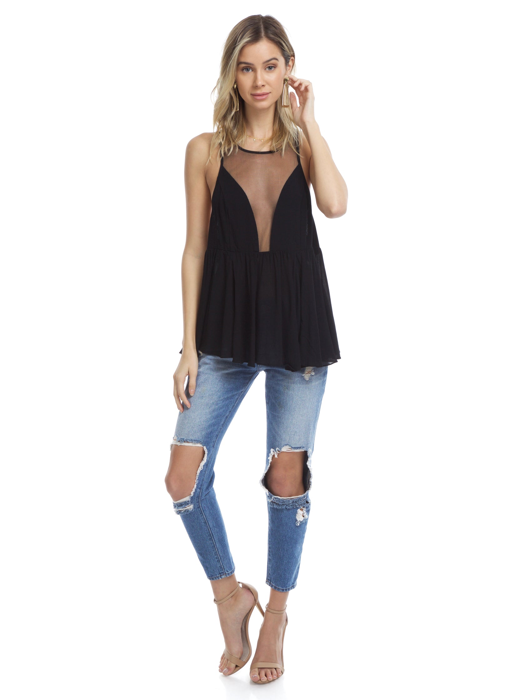 Girl wearing a top rental from Free People called Black Marble Cami